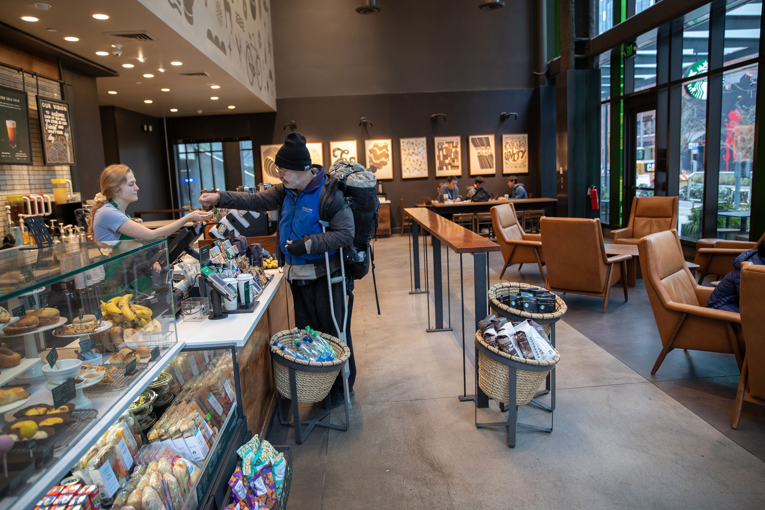 A person places an order at a Starbucks coffee shop in downtown Seattle on March 10.