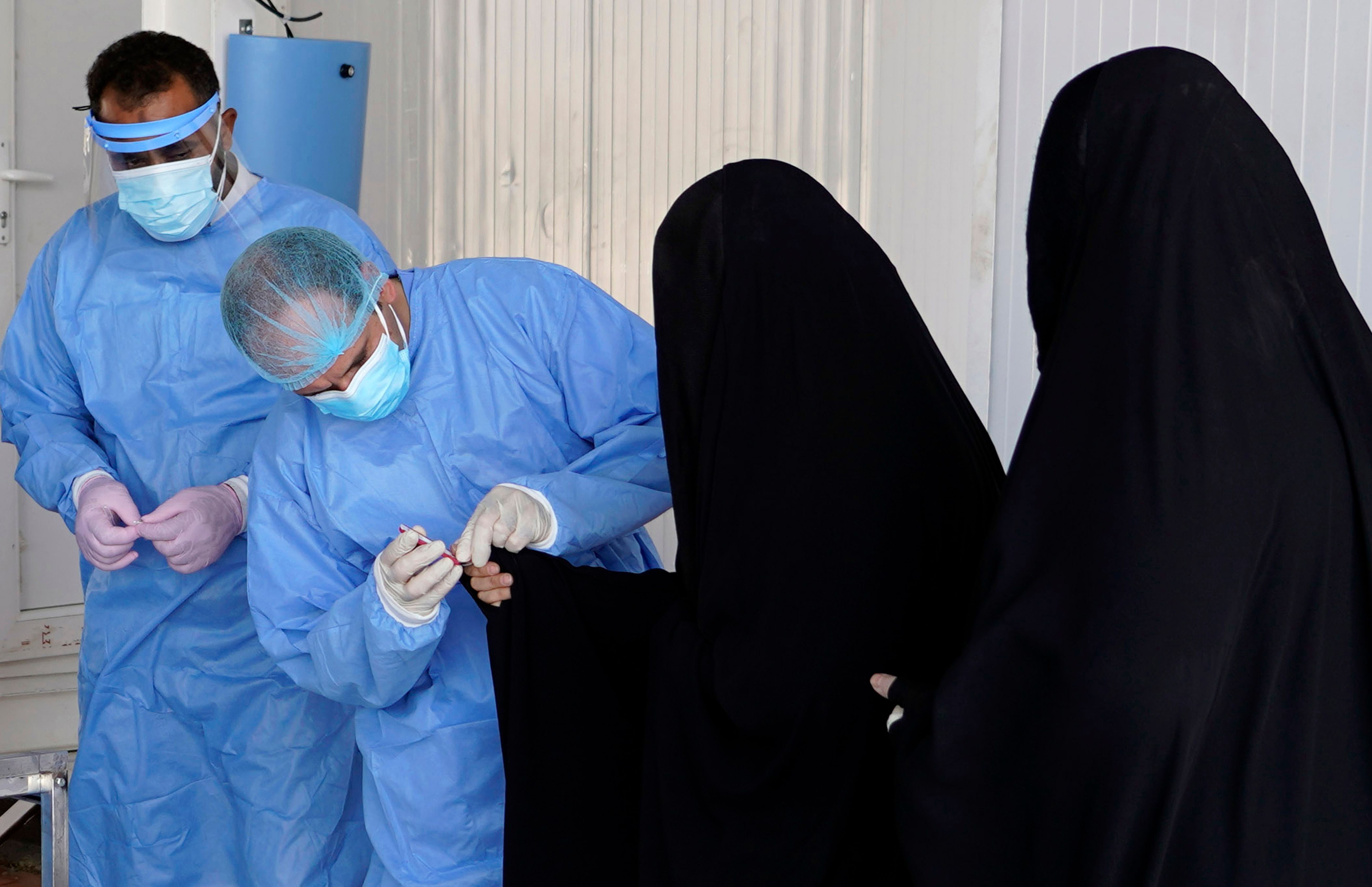 A health worker in Najaf, Iraq, administers a Covid-19 test on July 15.