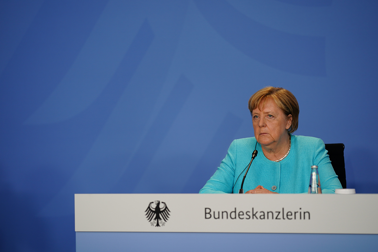 German Chancellor Angela Merkel speaks during a press conference as she meets with economic and financial organizations in Berlin at the German chancellery on August 26.