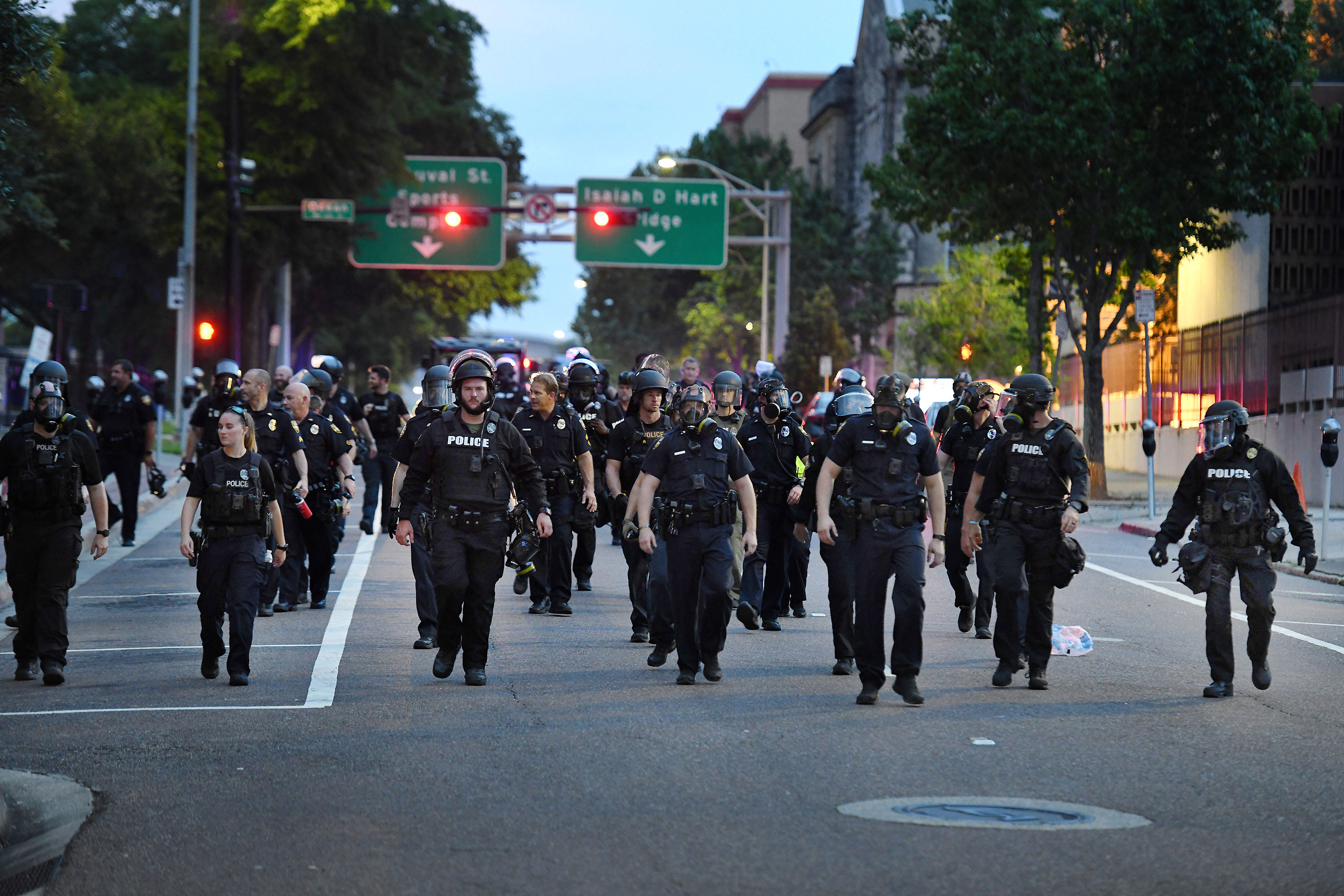 Police officers move down East Monroe Street toward Main Street in Jacksonville, Florida, on May 30.