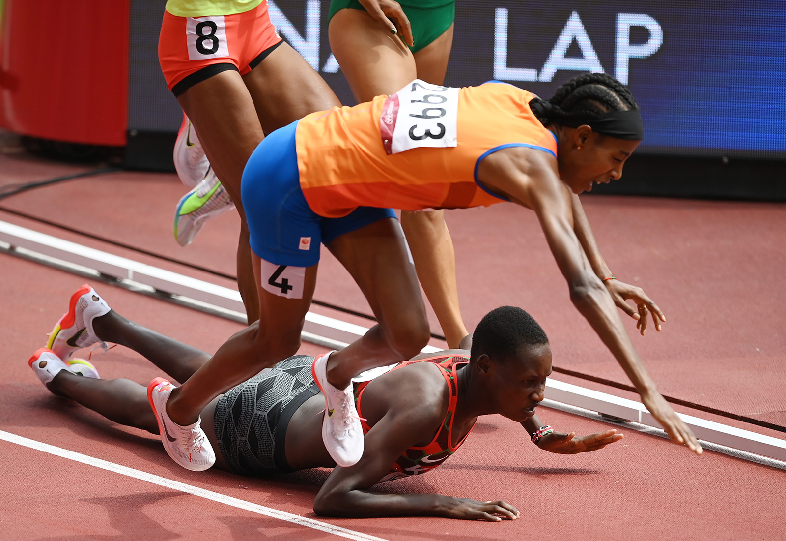 Dutch runner Sifan Hassan and Kenya's Edinah Jebitok trip and fall during a 1500 meter heat on August 2.