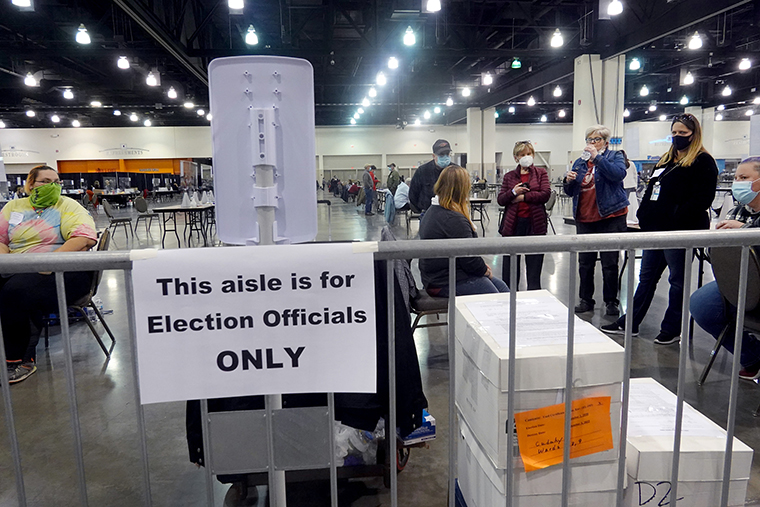 Election officials listen as procedural issues are argued during the process of recounting ballots from the November 3 election at the Wisconsin Center on November 20, in Milwaukee, Wisconsin.