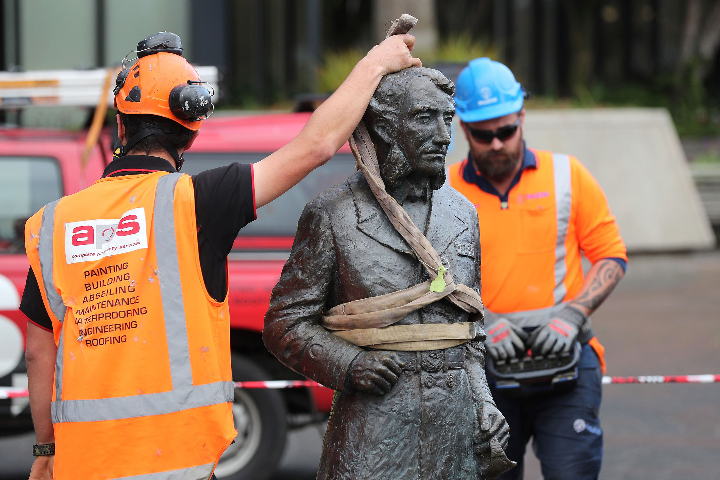 Workers remove a controversial statue of Captain John Fane Charles Hamilton from Civic Square in Hamilton, New Zealand, on June 12.