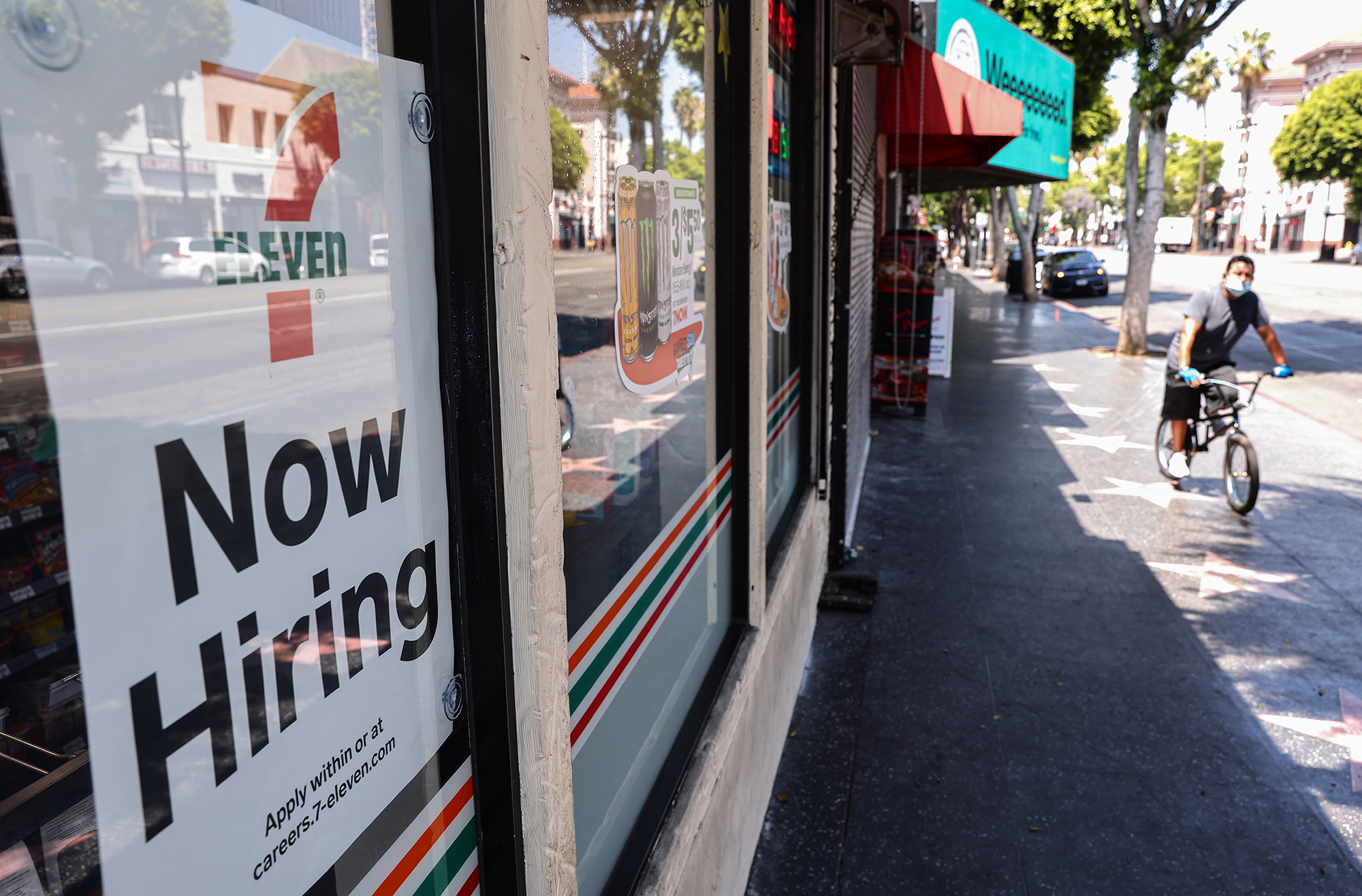 A 'Now Hiring' sign is posted at a 7-Eleven store on August 6, in Los Angeles, California.