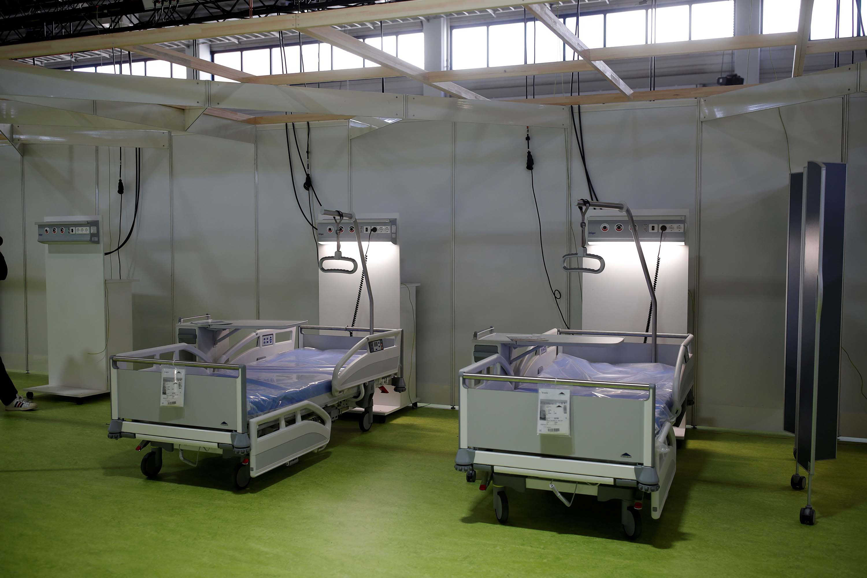 A makeshift hospital to treat coronavirus patients is prepared at the fairgrounds in Berlin, Germany, on April 23.