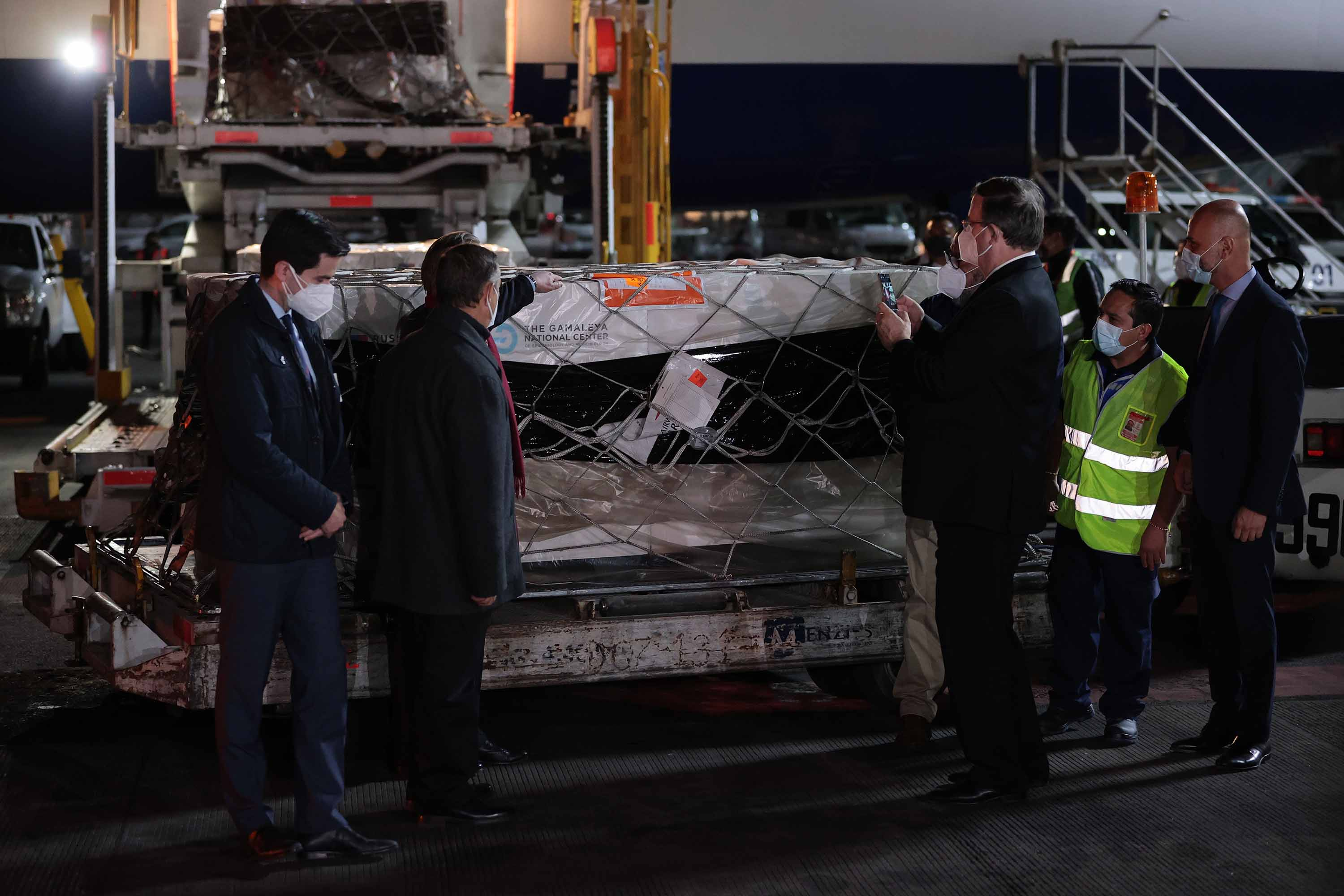 Viktor Koronelli, Russian ambassador in Mexico, and Marcelo Ebrard, Mexico's secretary of Foreign Affairs, with a container carrying the Sputnik V vaccine at Benito Juarez International Airport in Mexico City, on Monday.