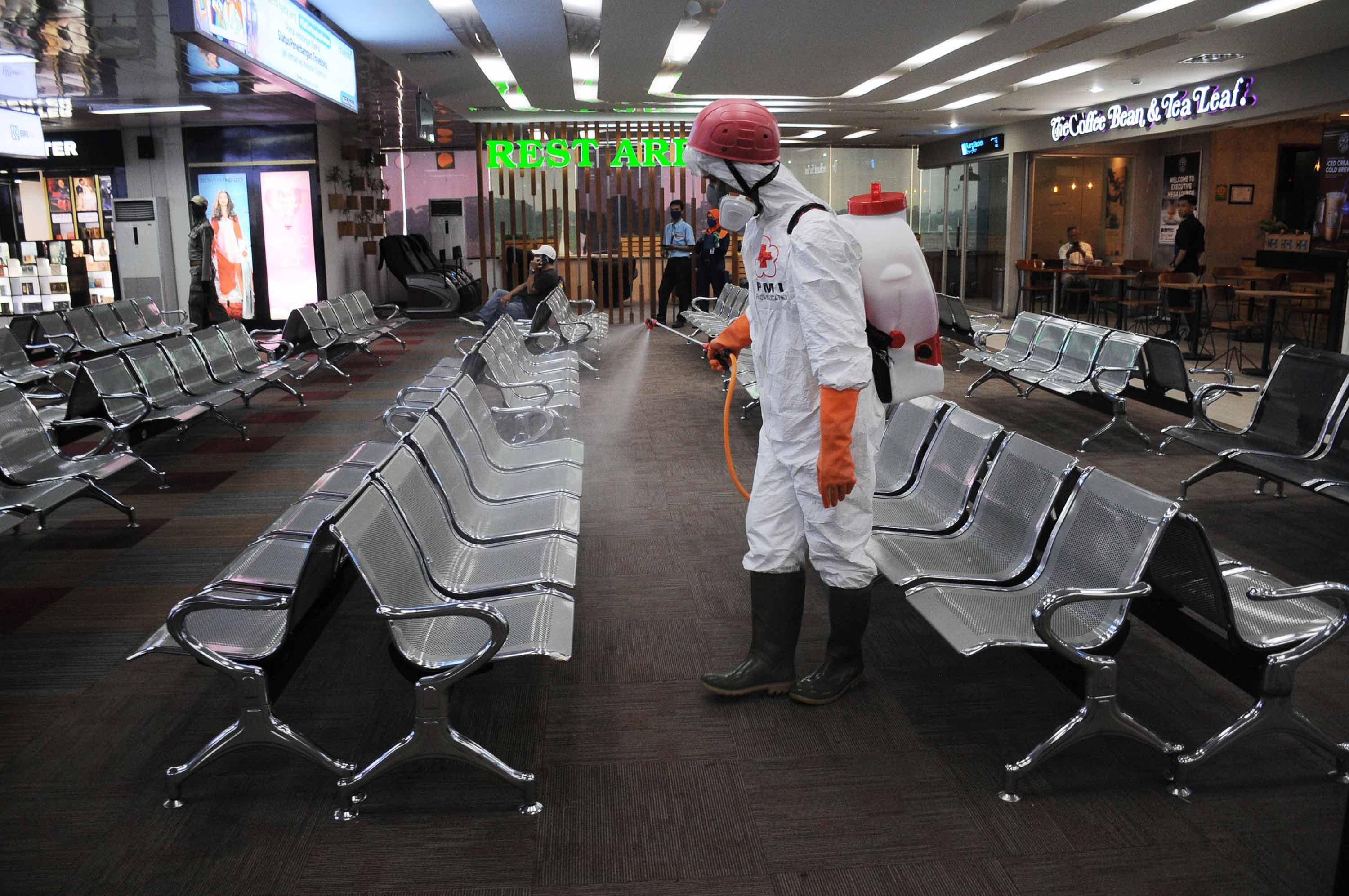 Officials spray disinfectant at Halim Perdanakusuma Airport in Jakarta, Indonesia on March 18.