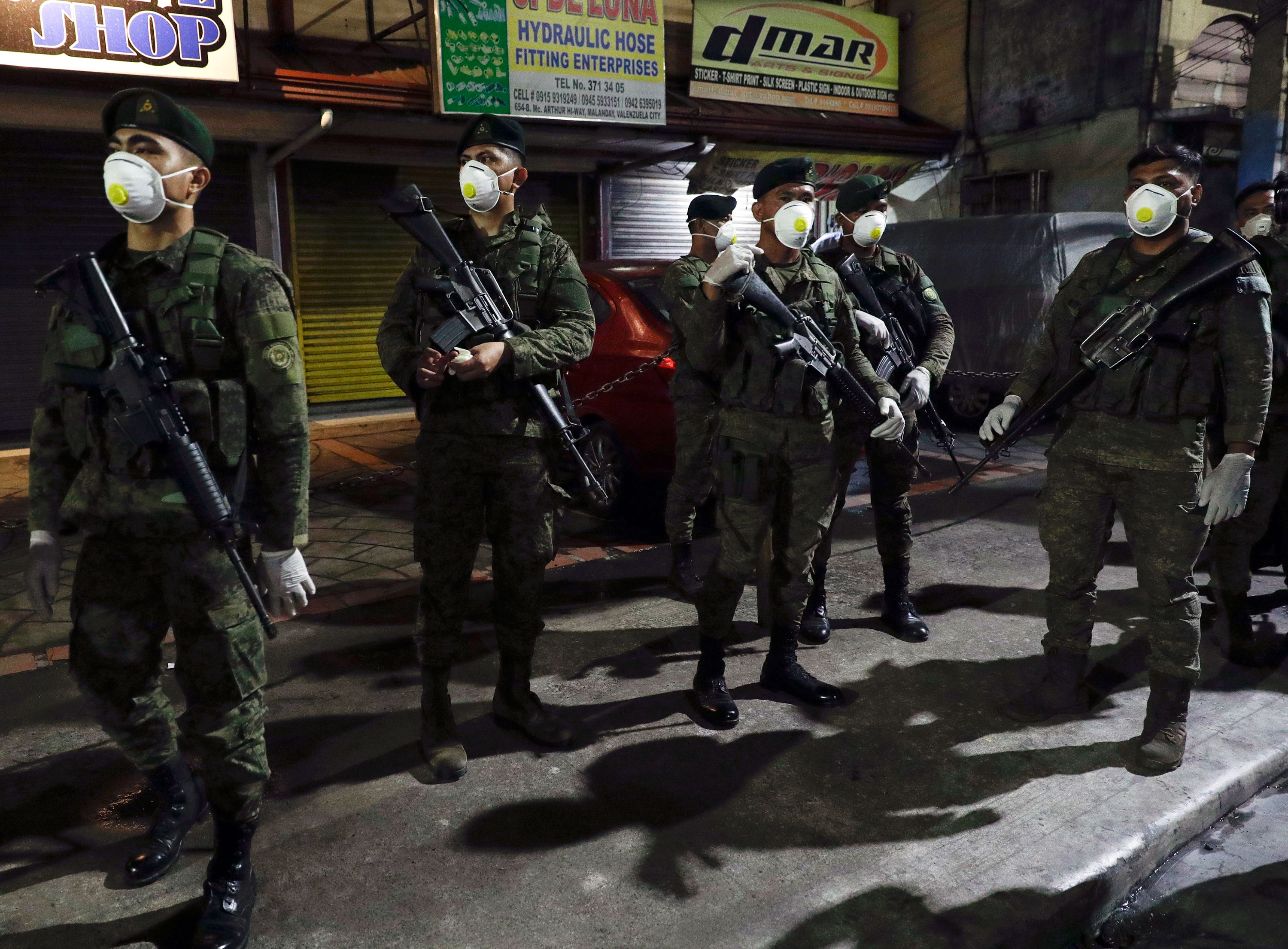 Filipino army troops arrive in metropolitan Manila, Philippines on March 15 to assist with the partial lockdown.