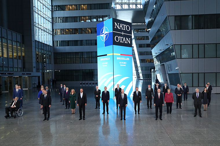 NATO leaders pose for a group photo during a NATO summit in Brussels, Monday, June 14, 2021.
