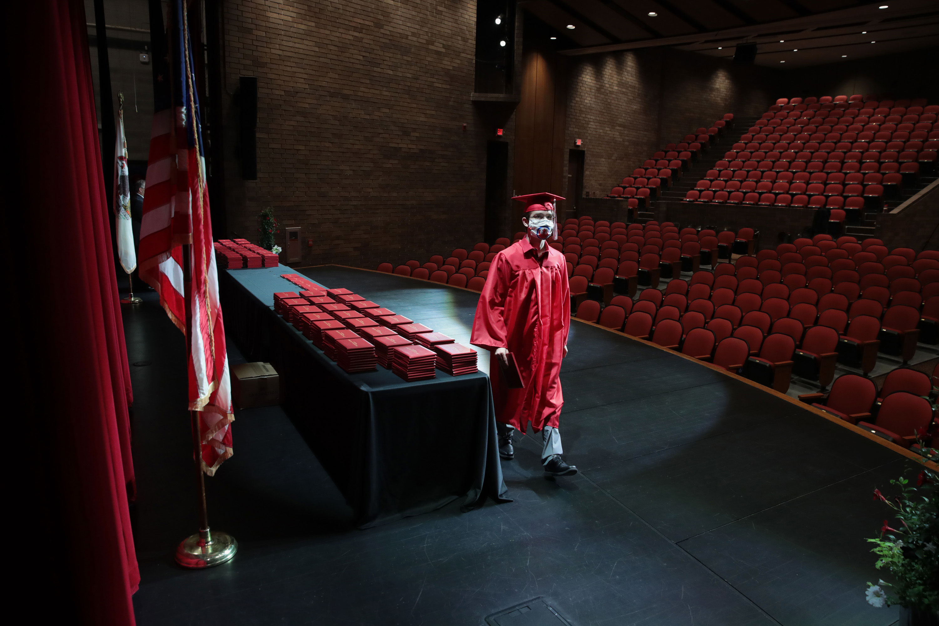 A student picks up his diploma during a graduation ceremony at Bradley-Bourbonnais Community High School on May 6 in Bradley, Illinois.