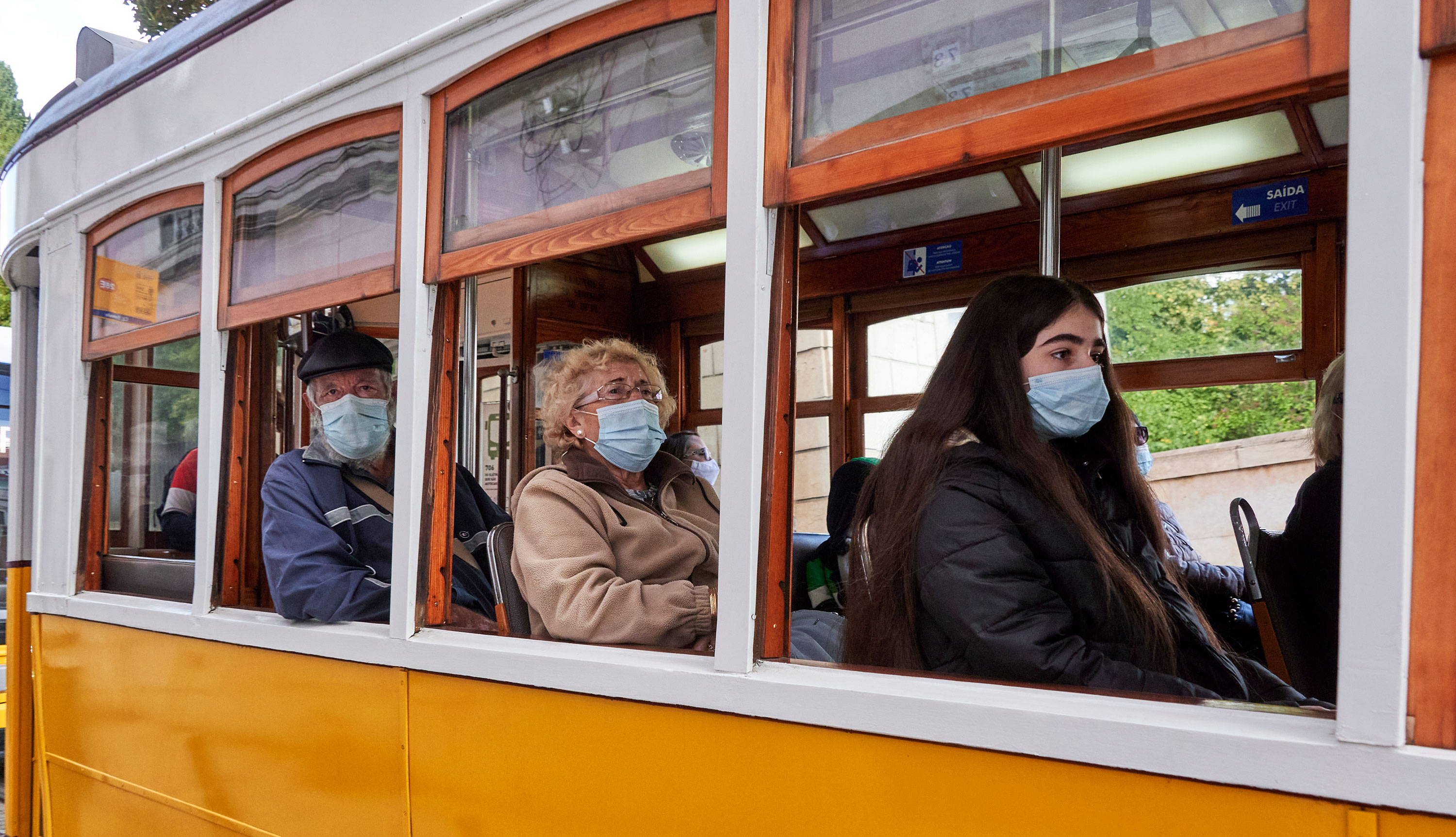 Passengers wear face masks while riding on a tram in Lisbon, Portugal on October 23.