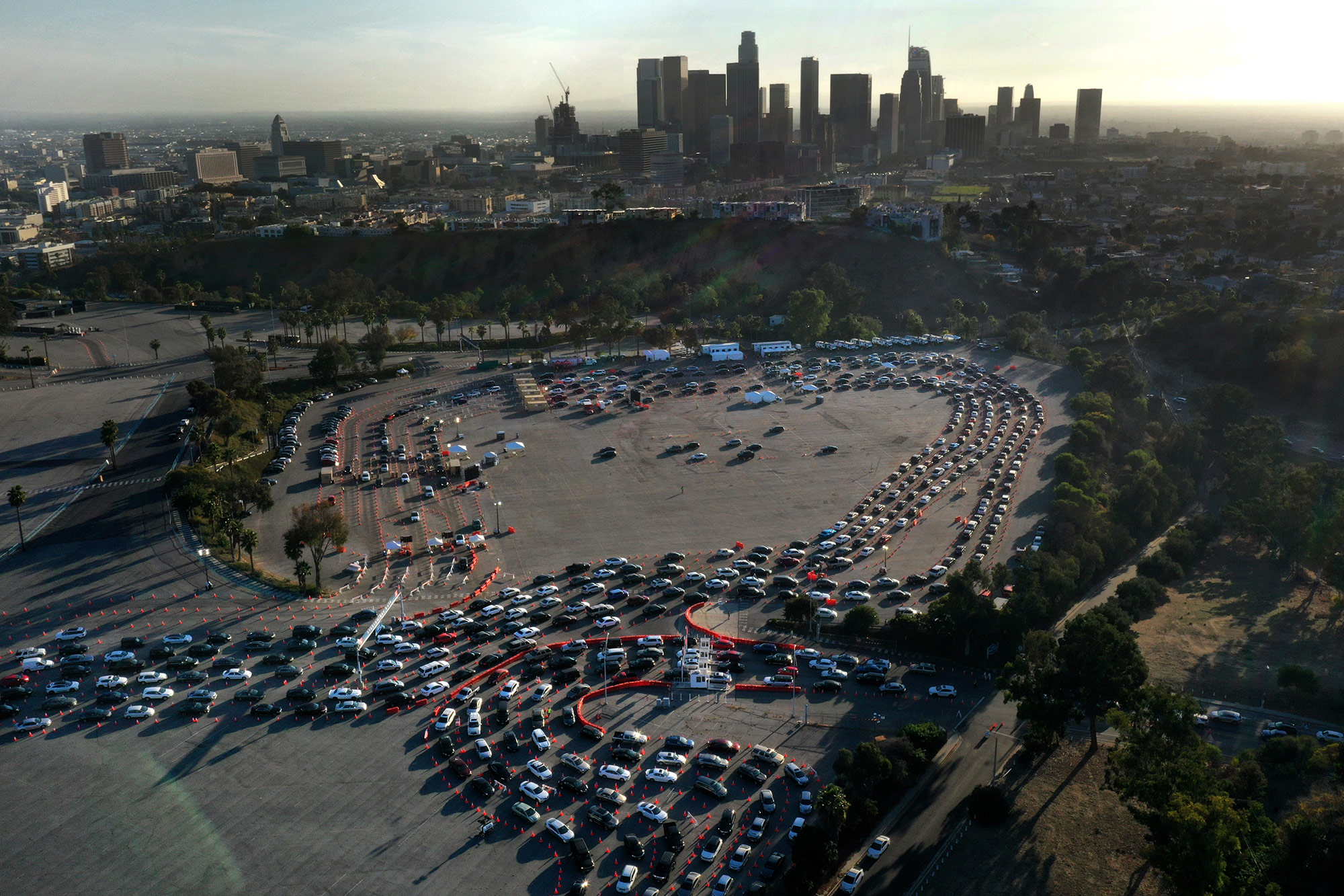 Cars line up at a coronavirus testing site at Dodger Stadium in Los Angeles on Monday.