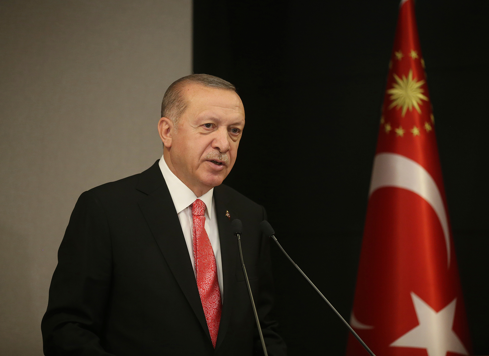 Turkish President Recep Tayyip Erdogan, talks during a televised address to the nation following a cabinet teleconference meeting, in Istanbul, Monday, May 11.