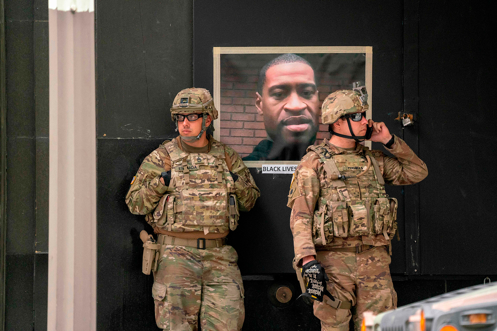 California National Guard soldiers stand near a portrait of George Floyd during a demonstration in downtown Los Angeles, on June 6.