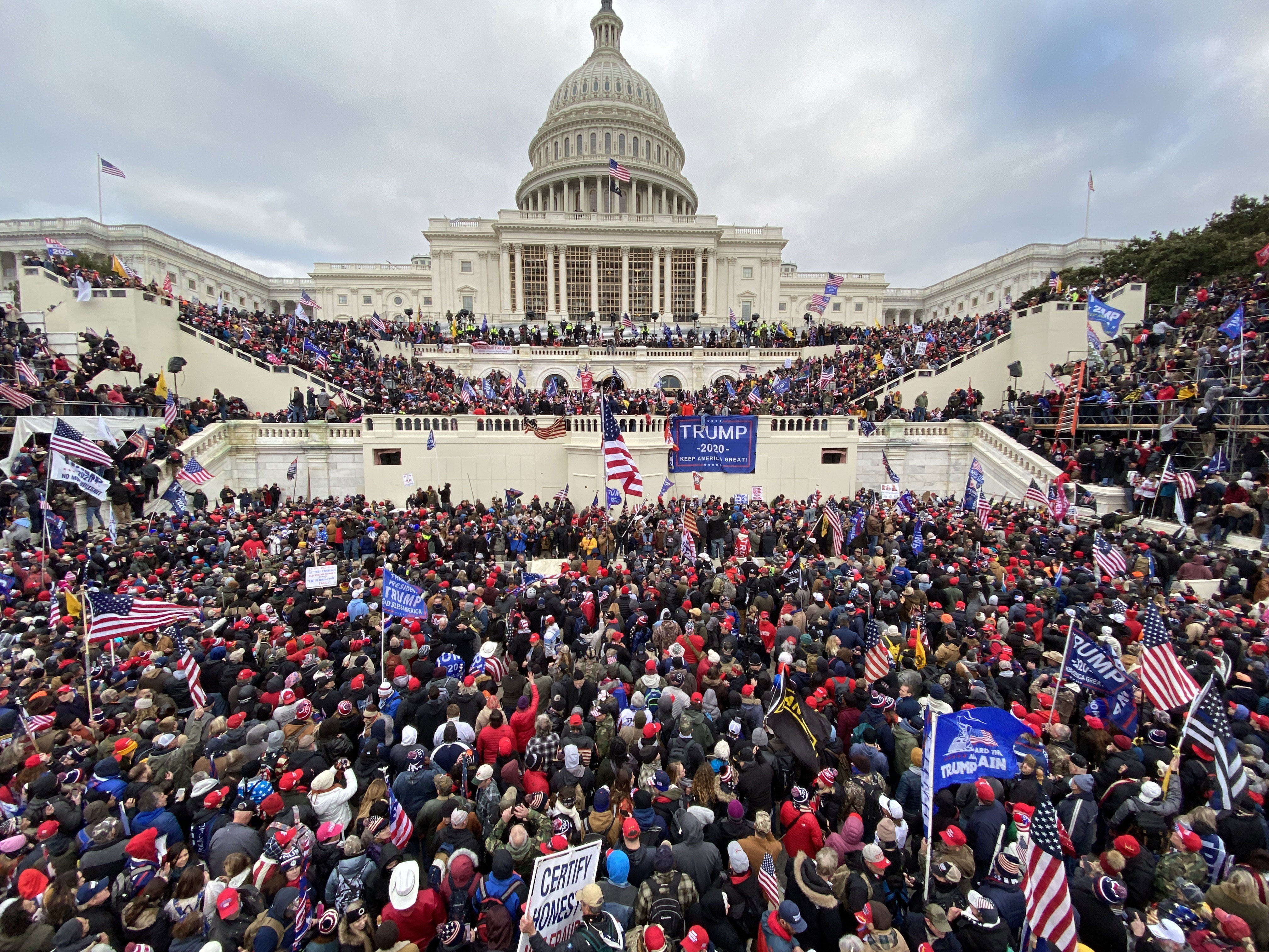 Rioters gather outside the Capitol on January 6.
