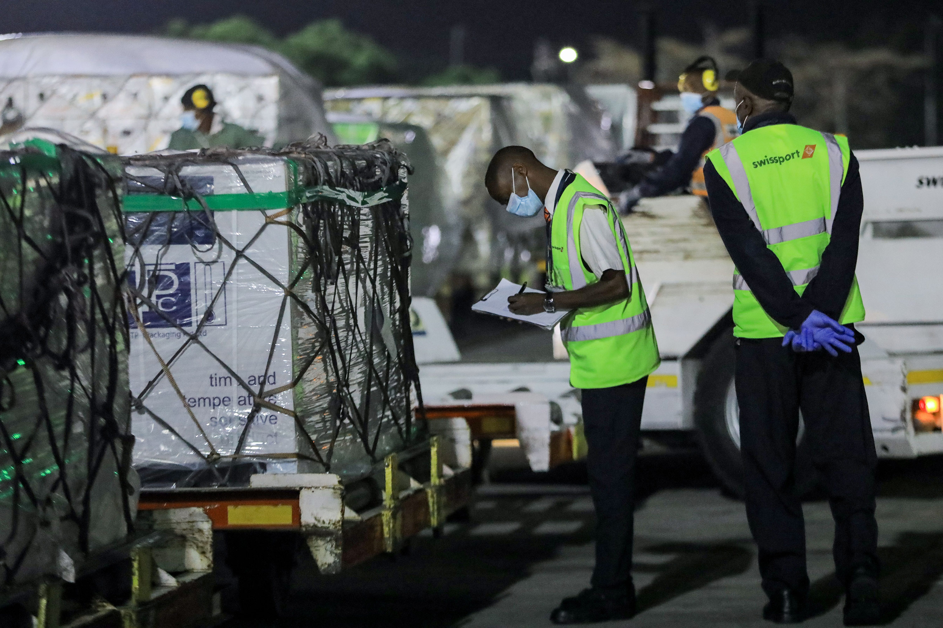 Oxford/AstaZeneca Covid-19 vaccines are unloaded after arriving at Jomo Kenyatta International Airport in Nairobi, Kenya, on March 3.