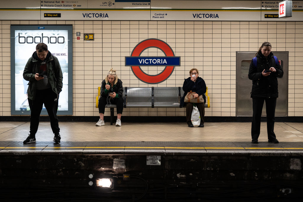 Commuters in a London Underground station on Wednesday.