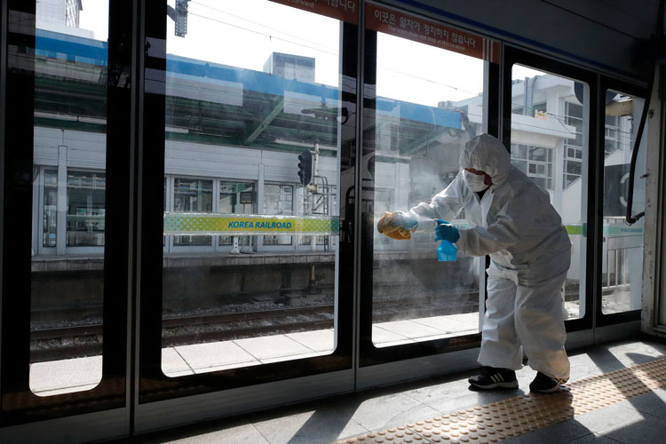 A worker disinfects a subway station in Seoul, South Korea, on March 13.