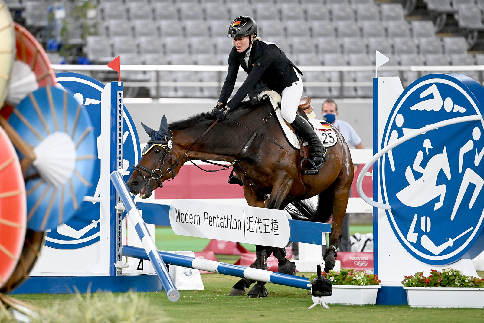 Annika Schleu of Germany, seen on the horse, Saint Boy, as the horse refuses to jump during the women's modern pentathlon on August 6, in Tokyo.