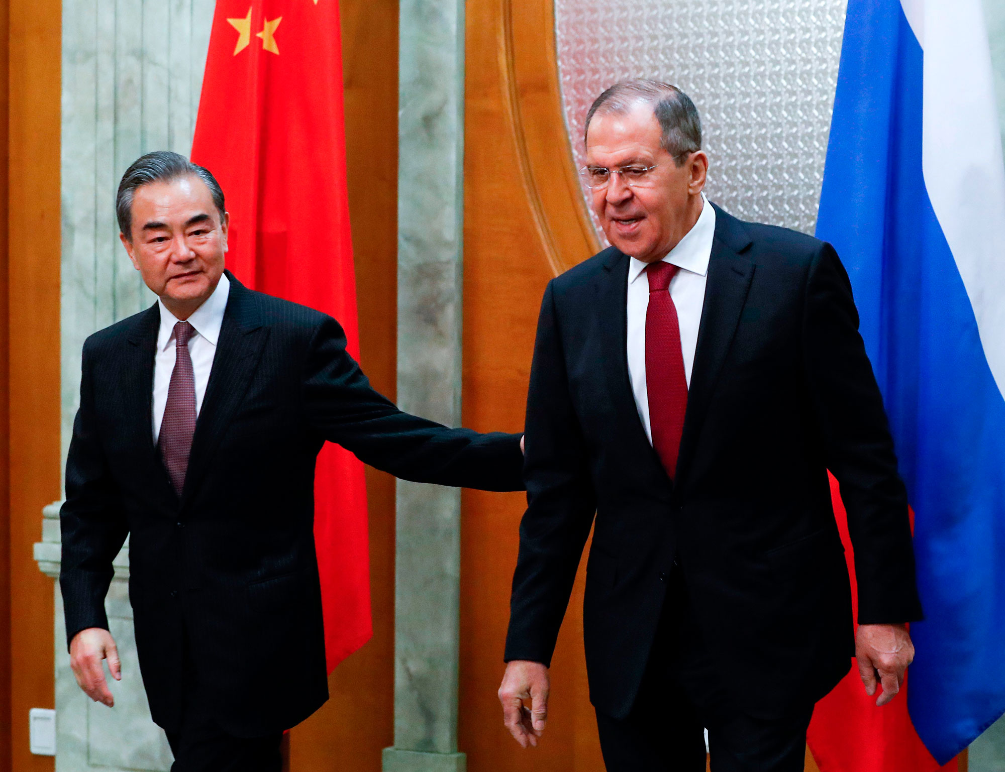 In this file photo, Russian Foreign Minister Sergei Lavrov, right, meets with his Chinese counterpart Wang Yi in Sochi on May 13, 2019.