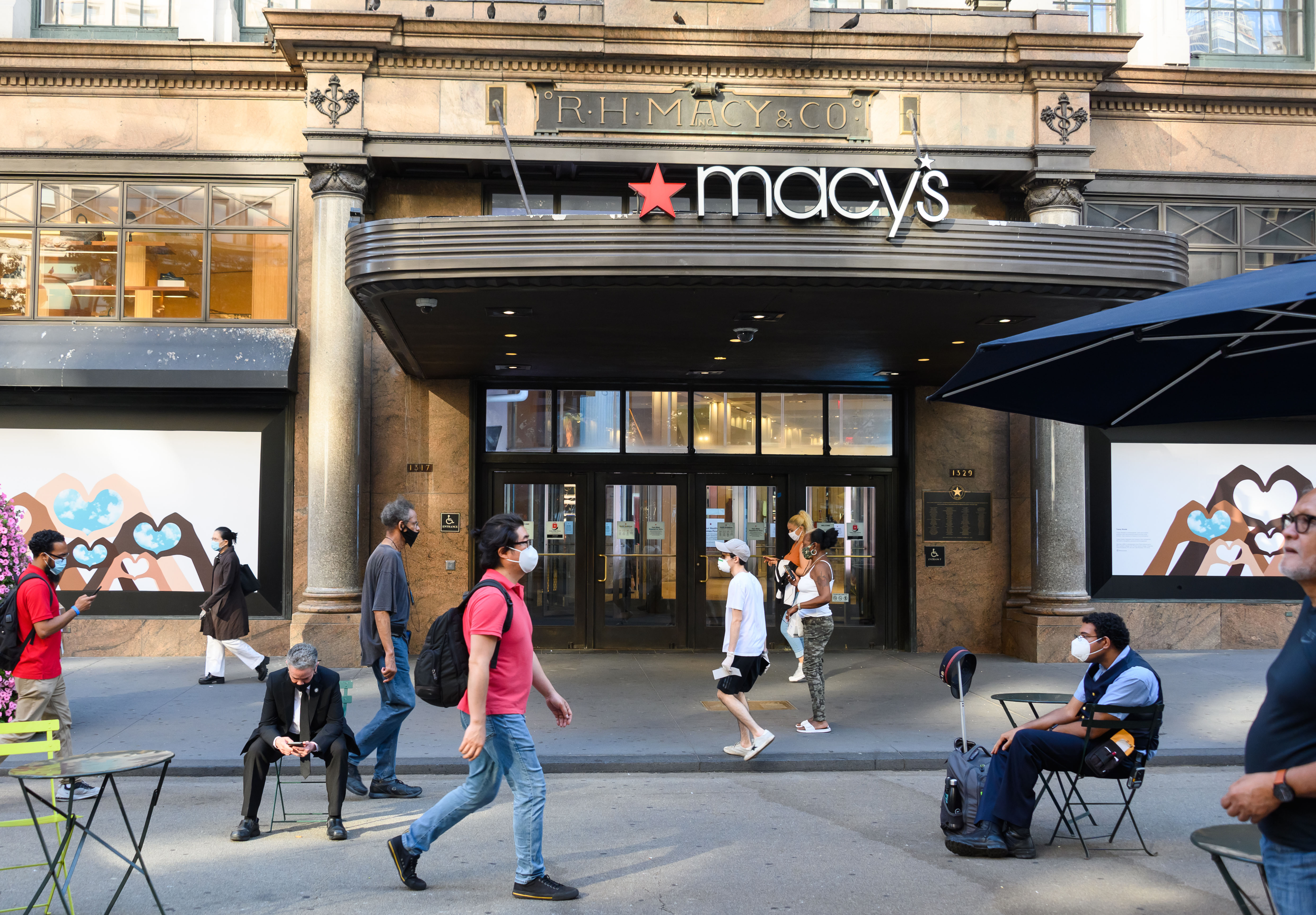 People walk by Macy's Herald Square in New York on June 23.