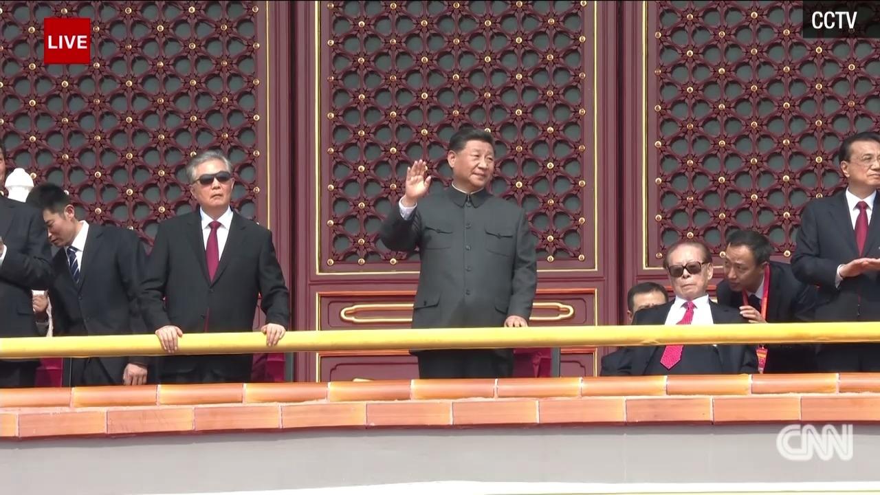 Jiang Zemin, seated to X