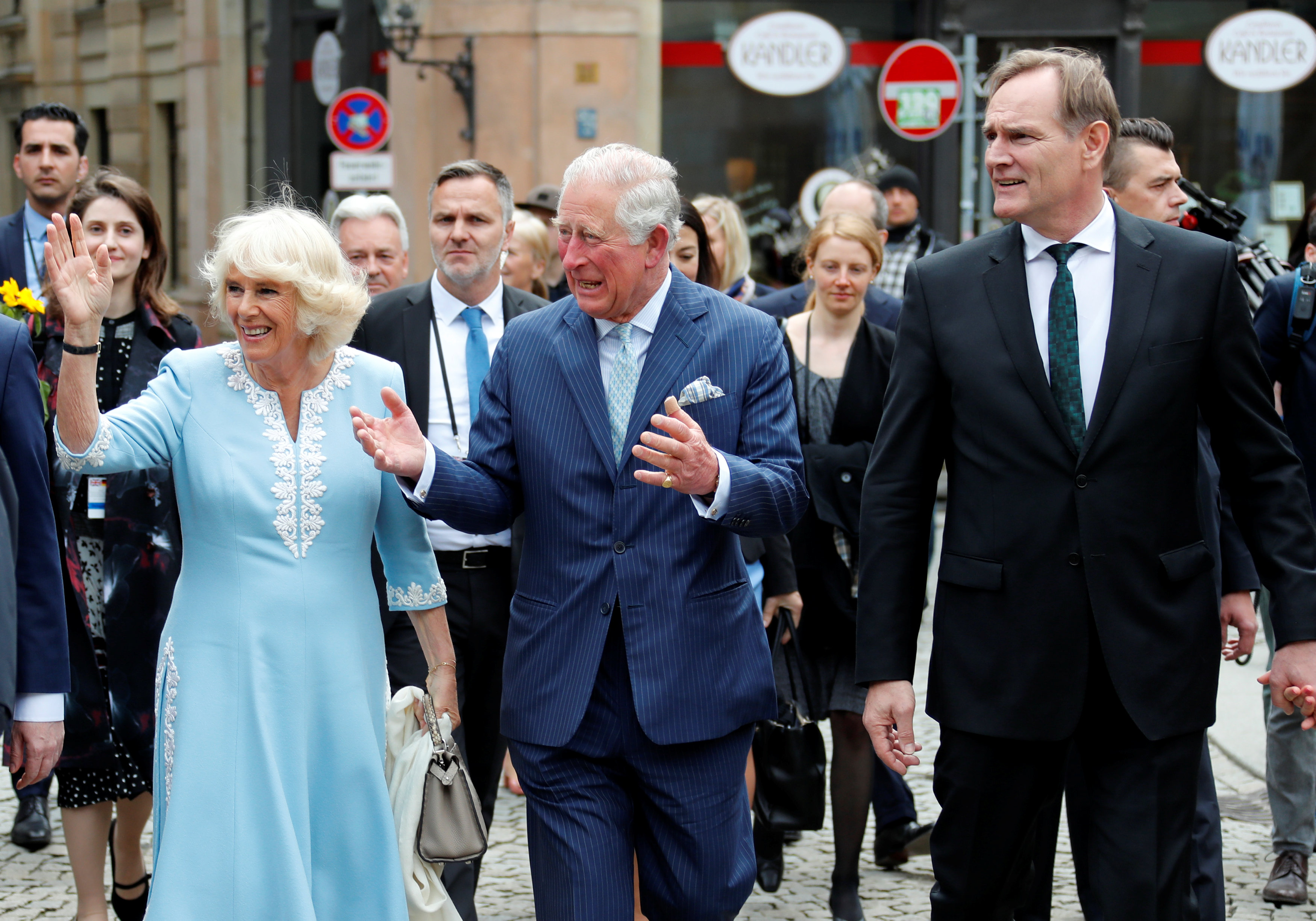 Britain's Prince Charles and Camilla, Duchess of Cornwall walk next to the Mayor of Leipzig Burkhard Jung.