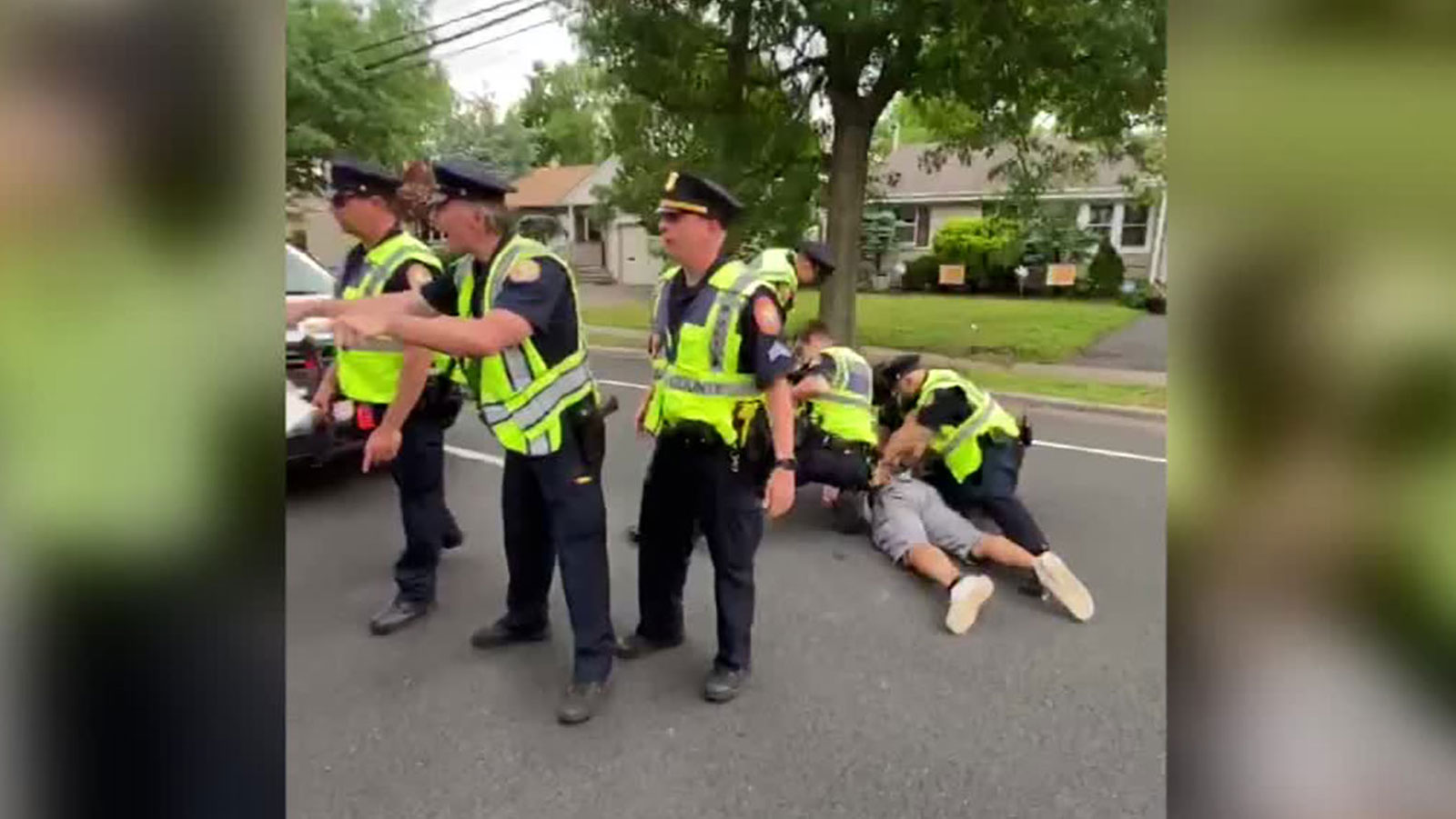 Video appears to show Nassau County police officers shoving black protester to ground, arresting him.
