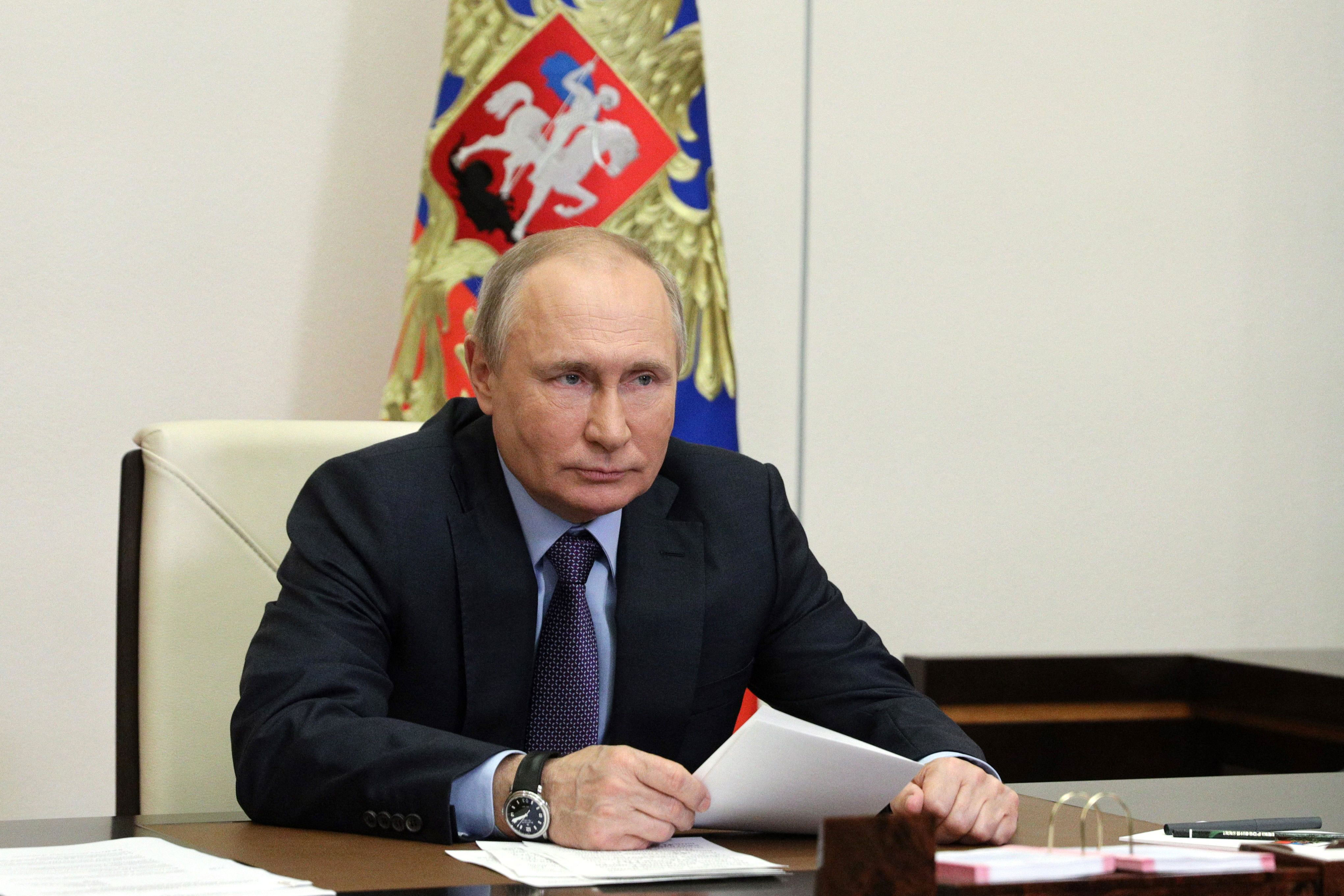 Russian President Vladimir Putin attends an event via video at the Novo-Ogaryovo state residence, outside Moscow, on June 9.