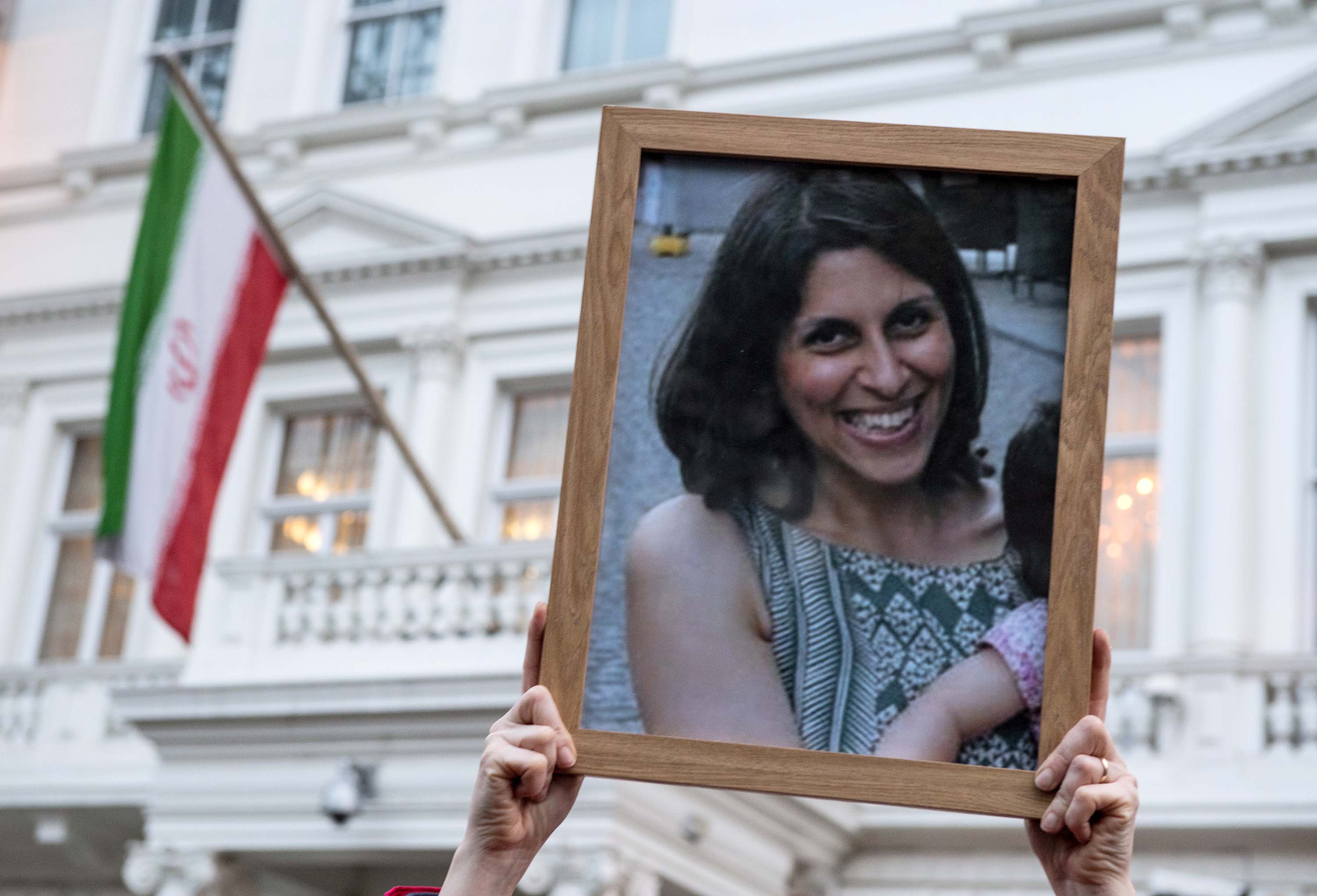 Supporters hold a photo of Nazanin Zaghari-Ratcliffe during a vigil for her outside the Iranian Embassy in London in January 2017.