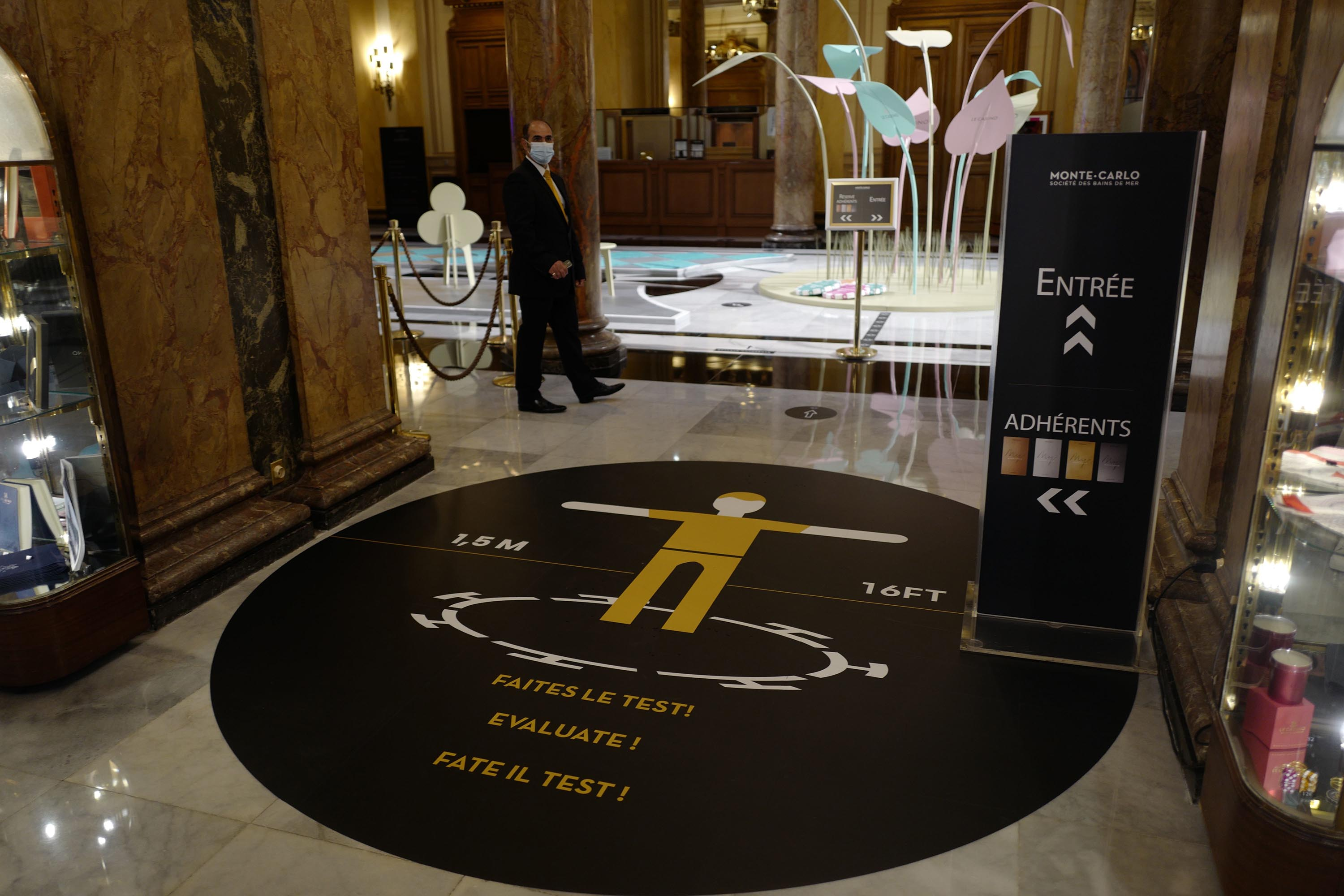Social distancing messages are pictured at the Casino de Monte-Carlo on June 4, in Monaco.