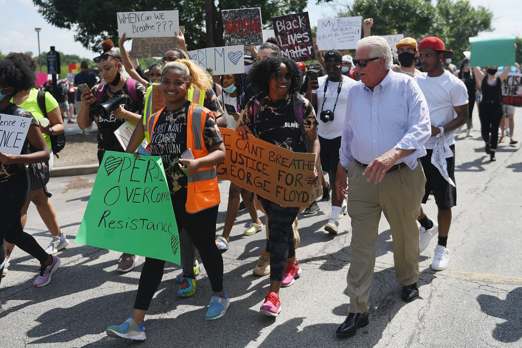 City of St. Charles Mayor Dan Borgmeyer walks with protesters during a demonstration against police brutality and the death of George Floyd on June 3.