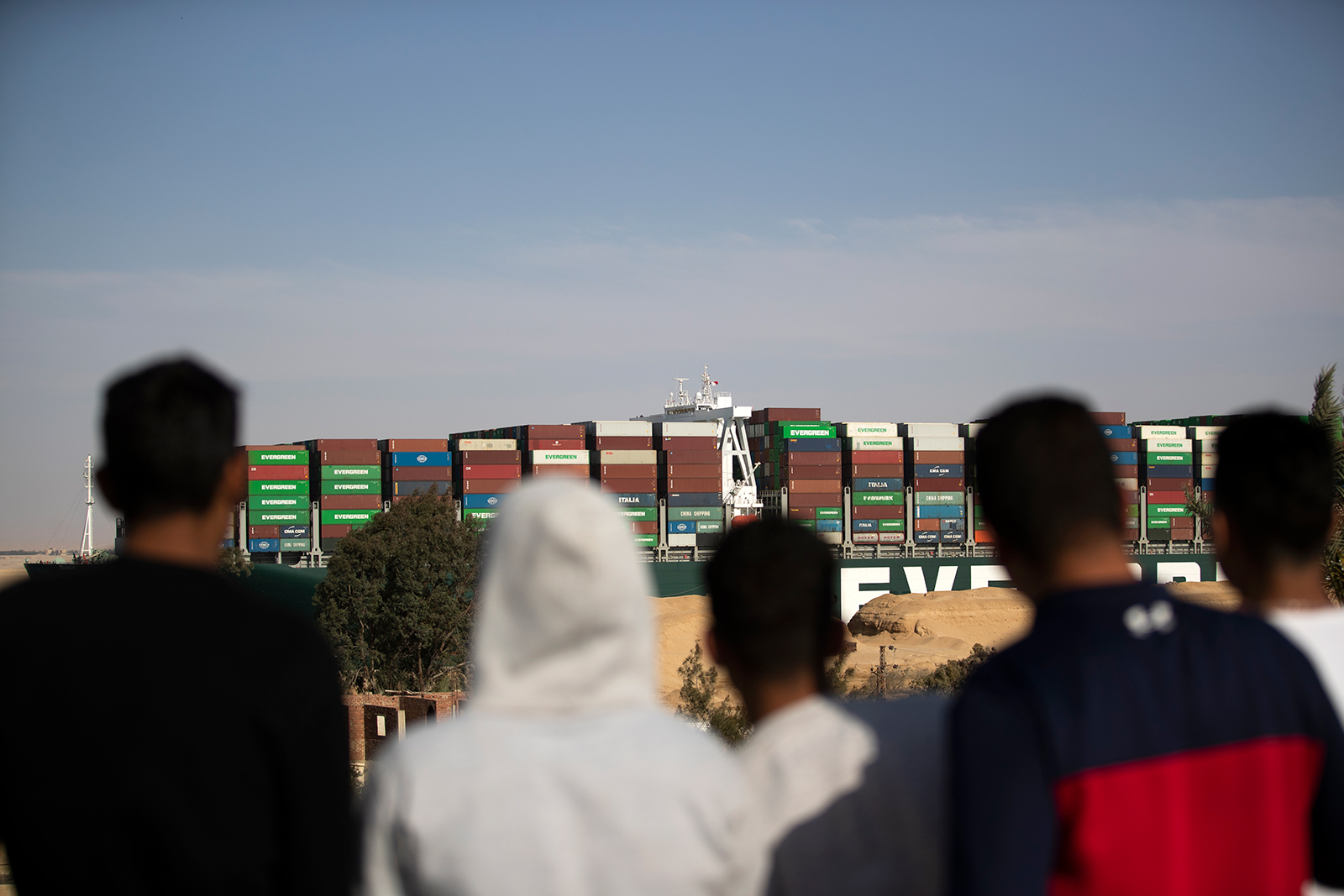 People watch as the container ship 'Ever Given' is refloated, unblocking the Suez Canal in Egypt, on March 29.