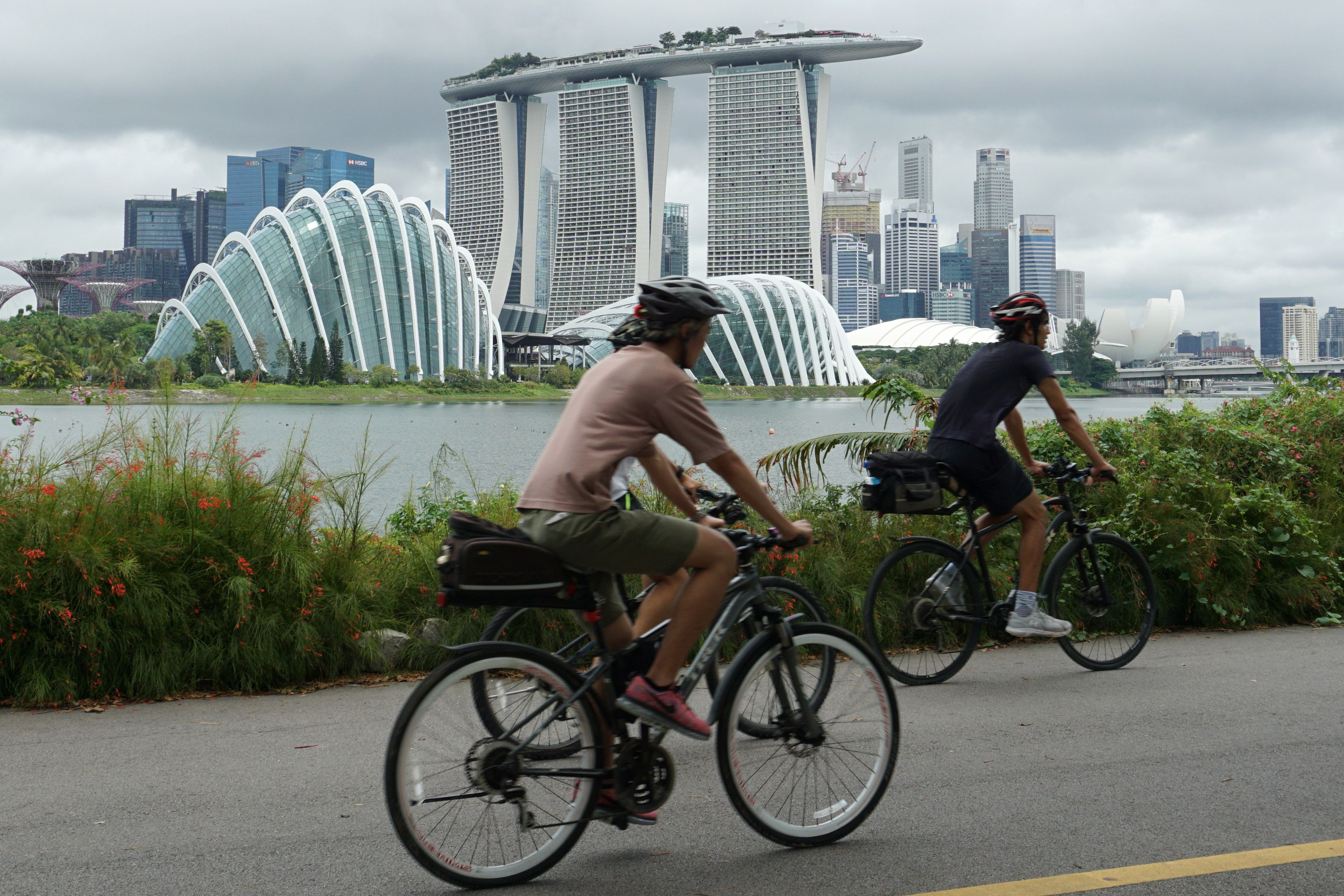 Cyclists riding along Marina Bay overlooking the financial business district in Singapore on July 14.