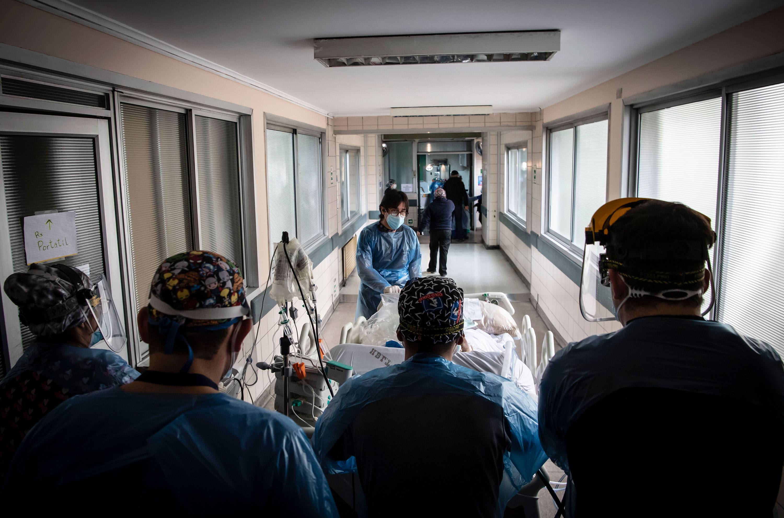Nurses transfer a patient at Barros Luco Hospital in Santiago, Chile, on June 24.