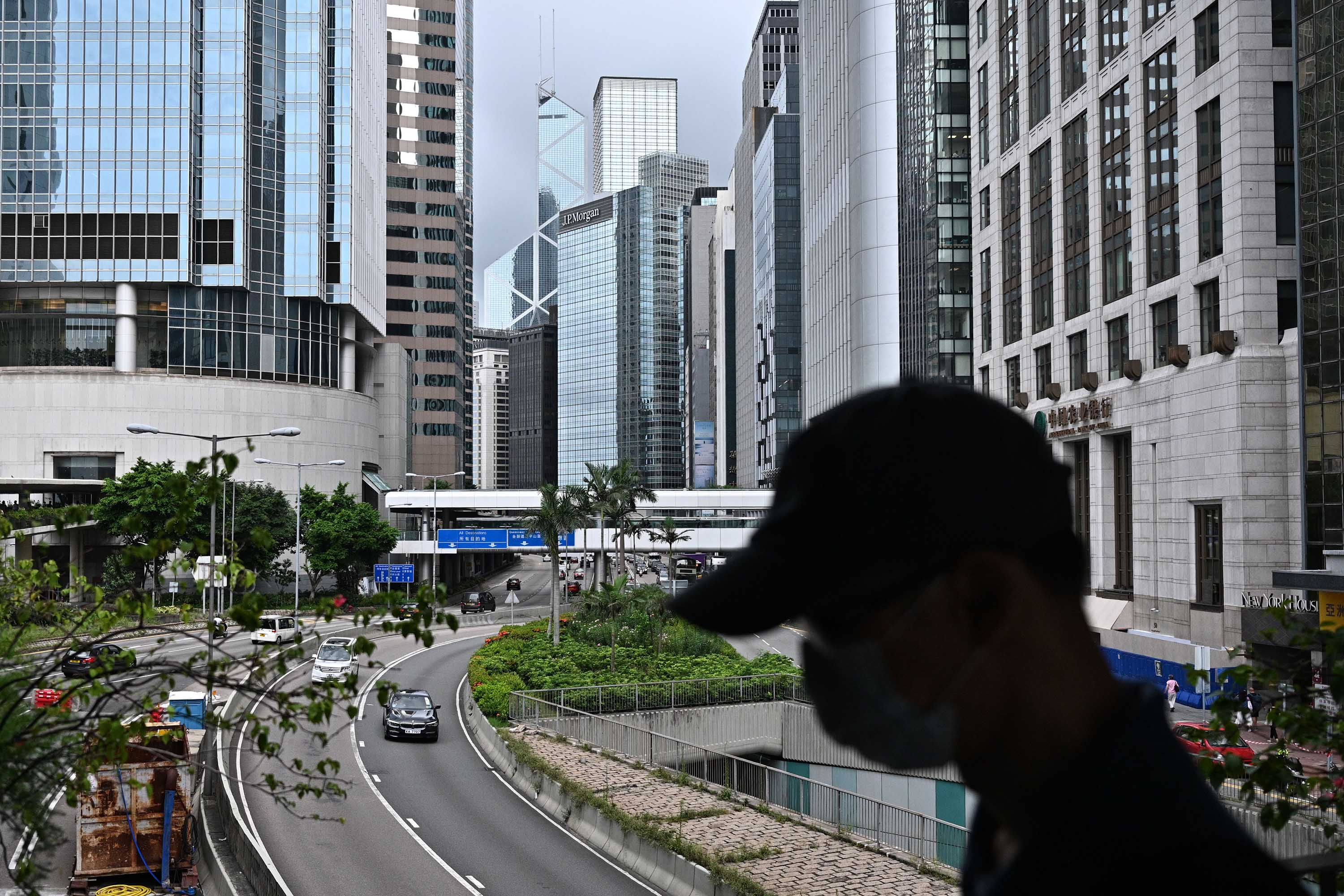 A pedestrian wearing a face mask walks in Hong Kong's Central district on July 9.