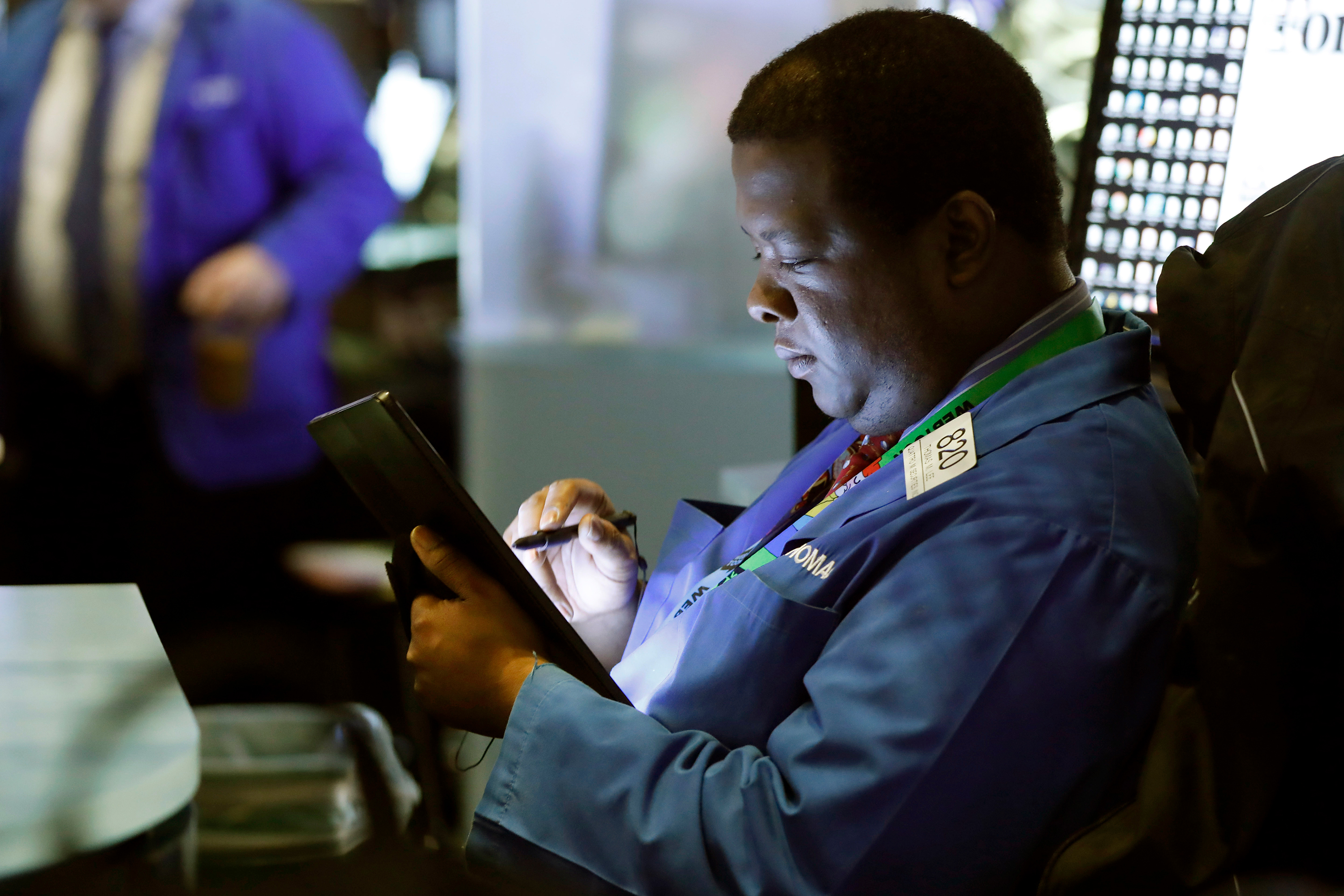 Trader Thomas Lee works on the floor of the New York Stock Exchange, Tuesday, March 10, 2020.