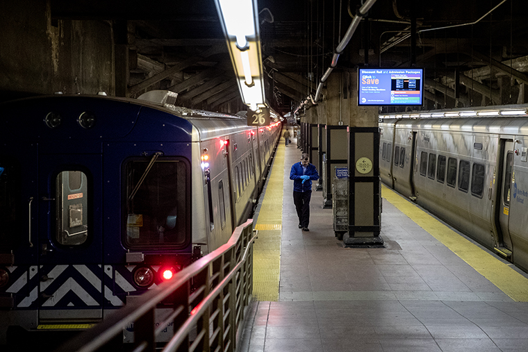 A MTA employee walks along a train platform at Grand Central Station in New York, on Wednesday, April 1.