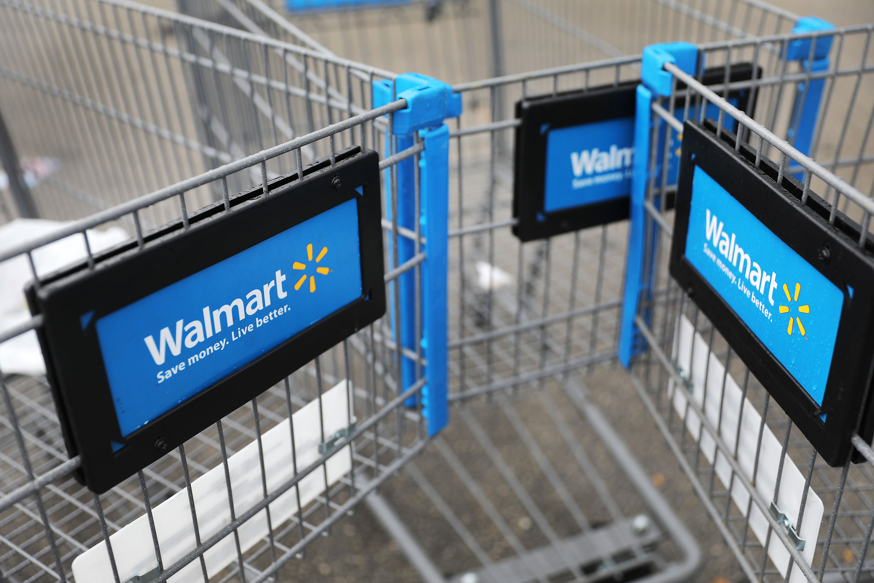 Shopping carts are seen outside of a Walmart store in Miami, Florida on February 18.