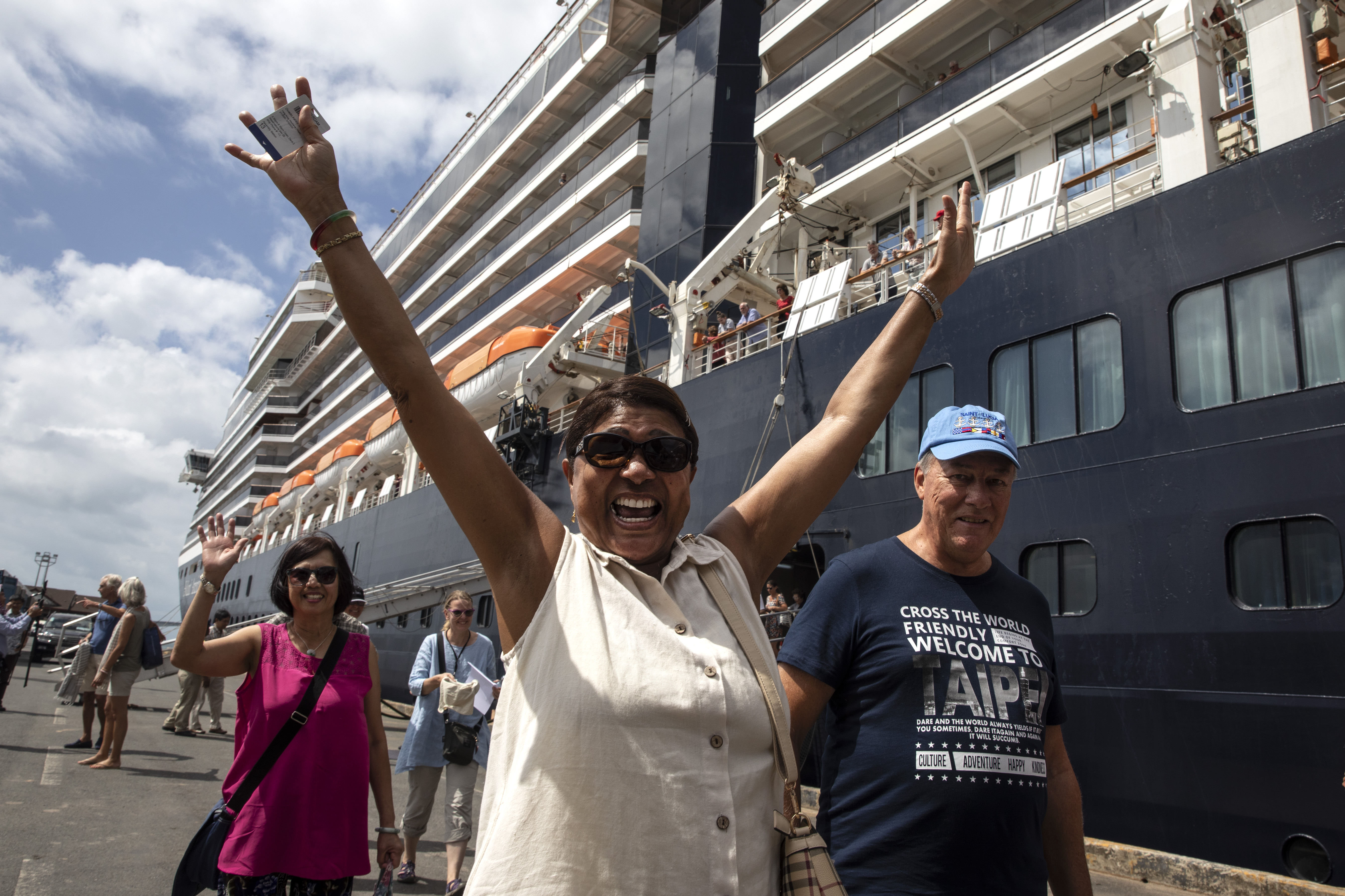 Excited passengers disembark the Westerdam cruise ship on February 14, 2020 in Sihanoukville, Cambodia