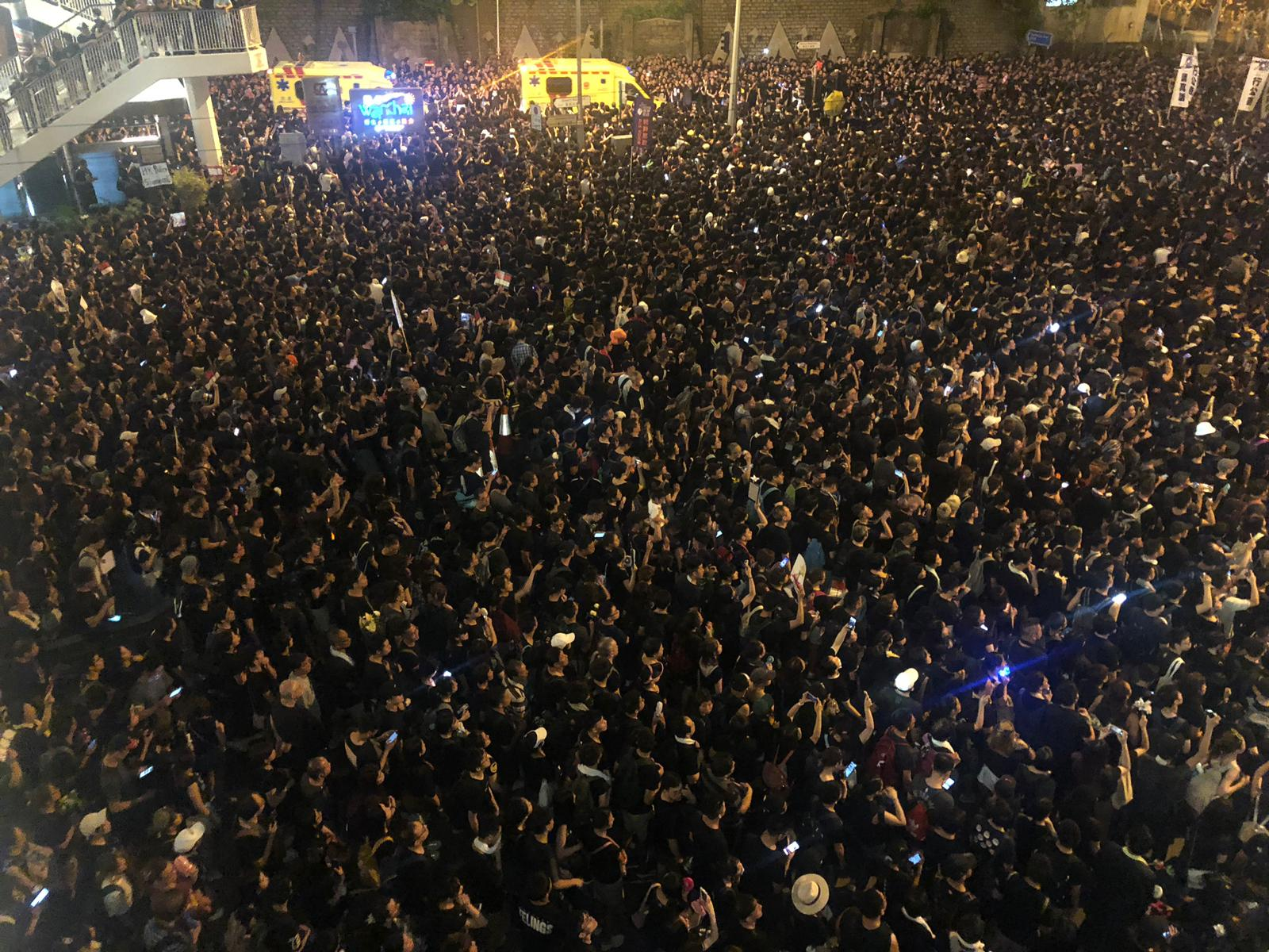Crowds continue to surge through Hong Kong late into Sunday night.