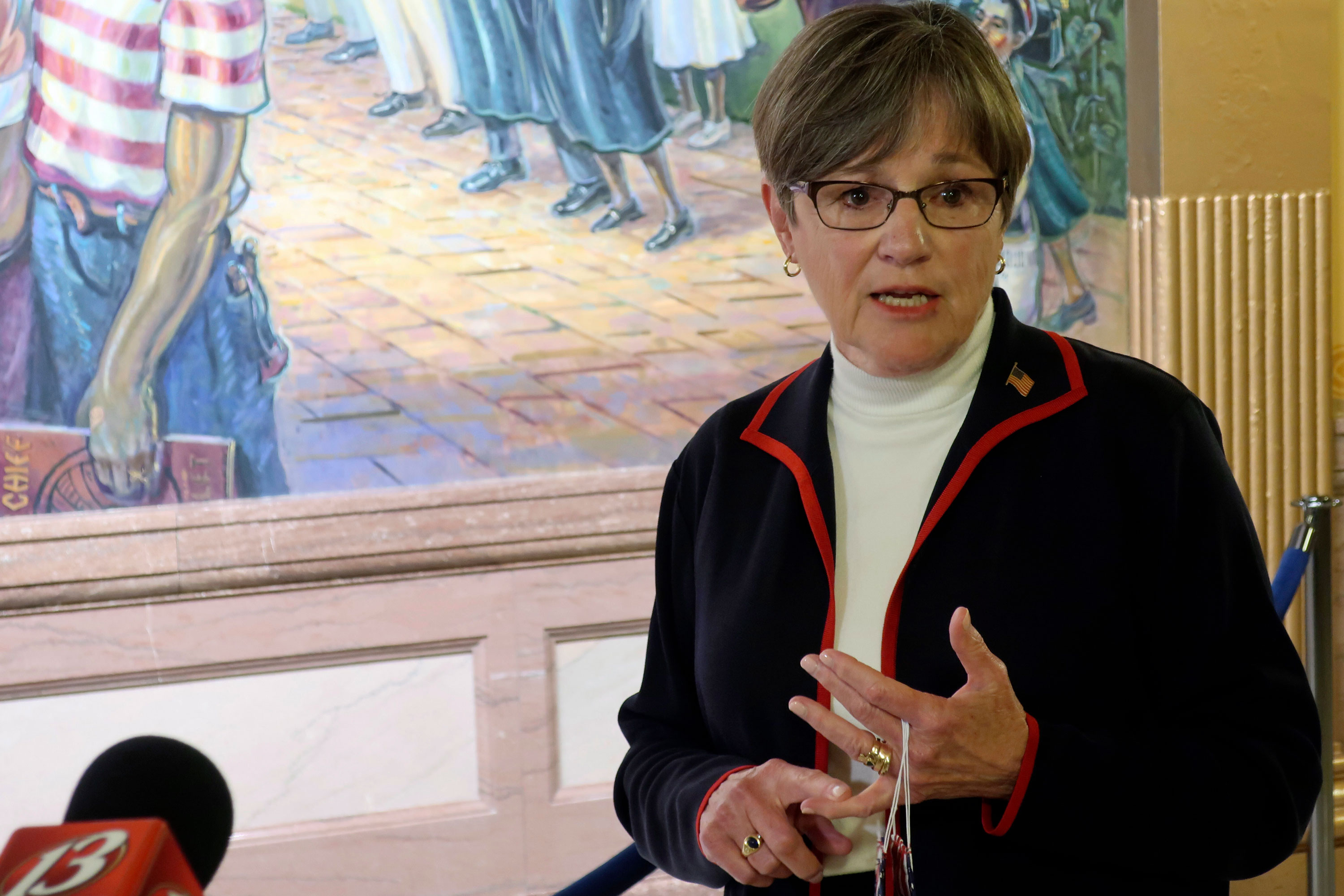 Kansas Gov. Laura Kelly answers questions from reporters about the coronavirus pandemic on July 2 at the Statehouse in Topeka, Kansas.