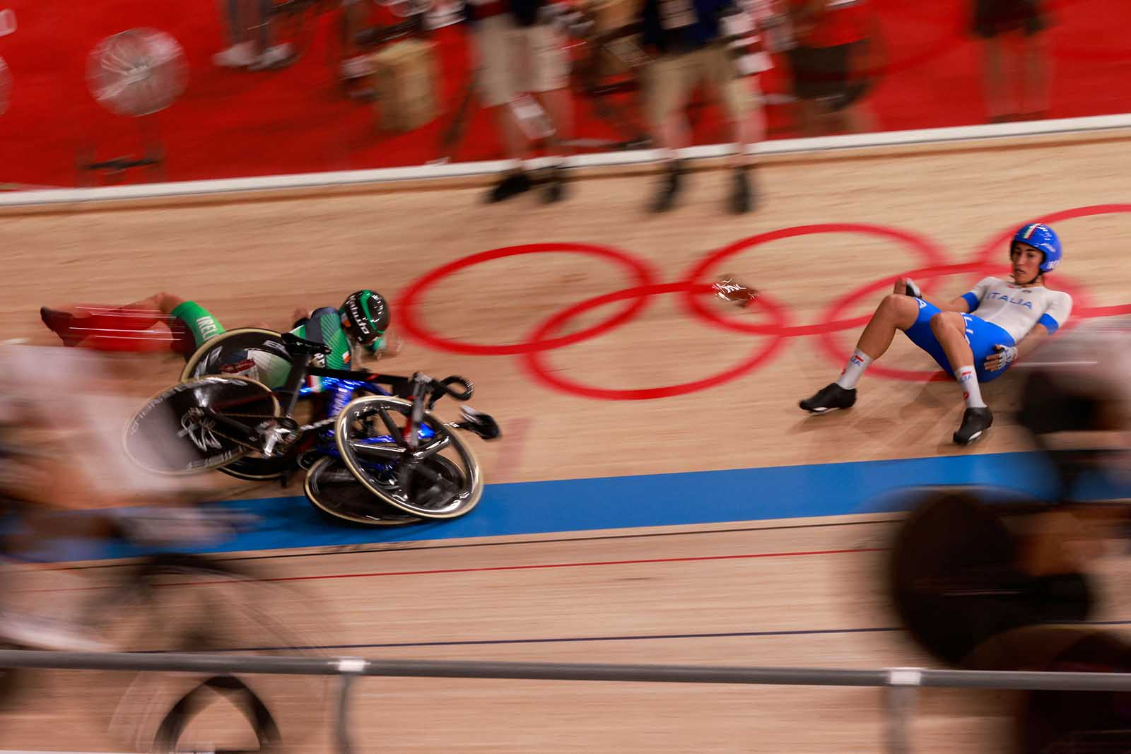 Italy's Elisa Balsamo, right, reacts after a crash in the women's track cycling Madison final on August 6.