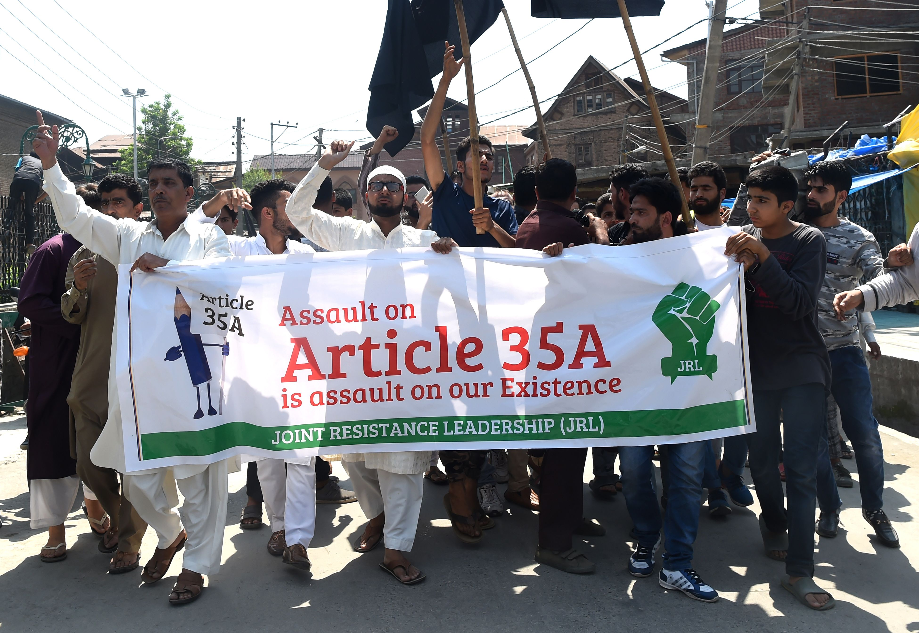 Kashmiri Muslims shout anti-Indian slogans during a demonstration in Srinagar on Saturday against revoking Article 370.