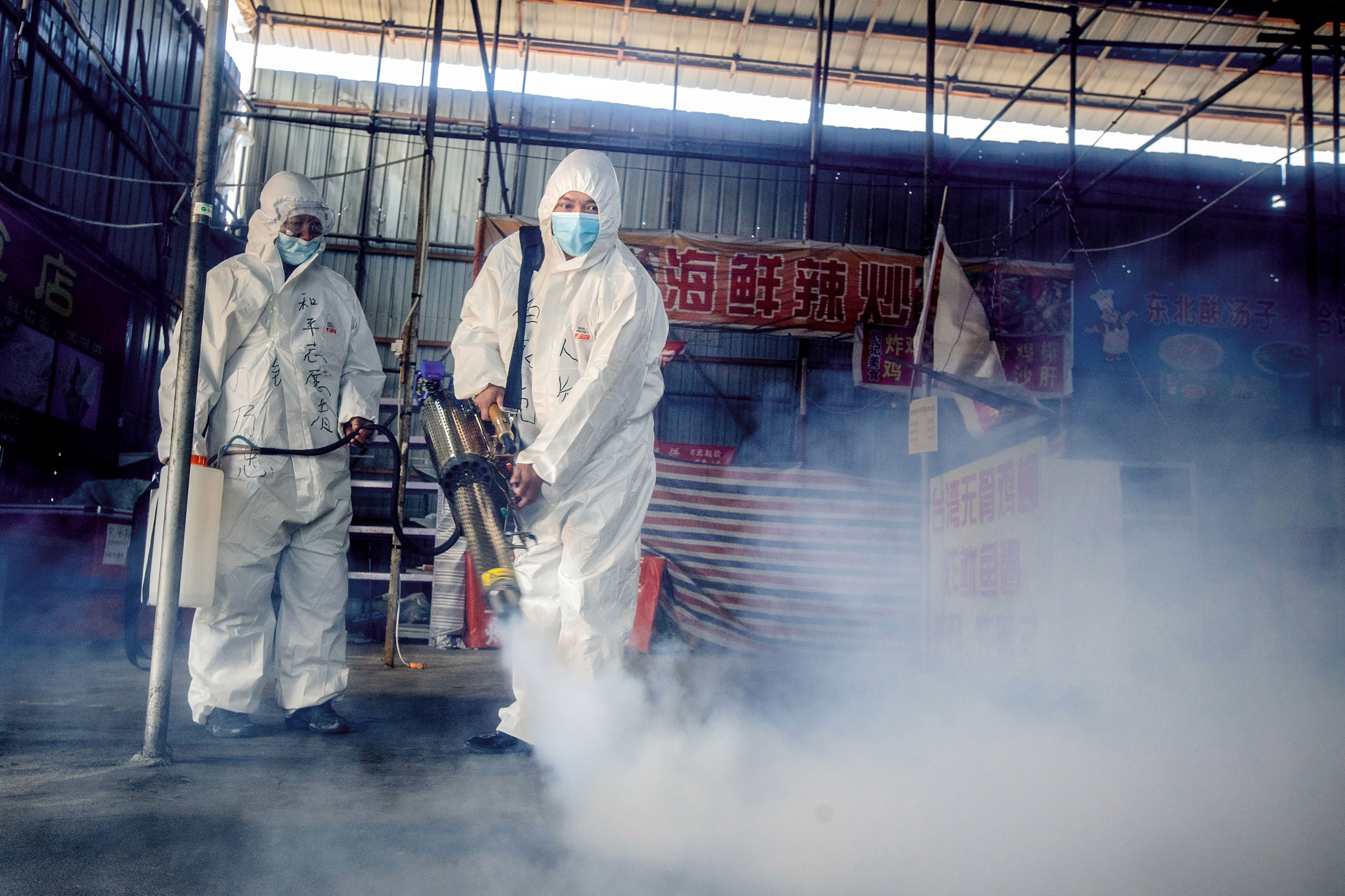 Volunteers spray disinfectant at a market on May 6 as the city of Suifenhe, China prepares to reopen.