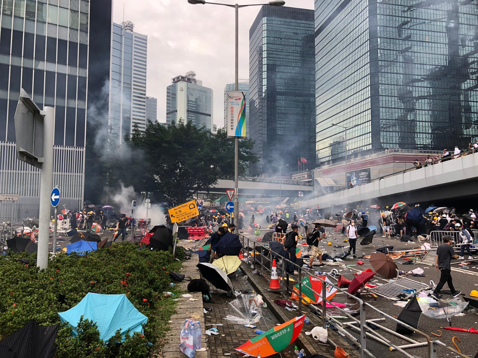 Tear gas can be seen on Harcourt Road, near to the Legislative Council building.