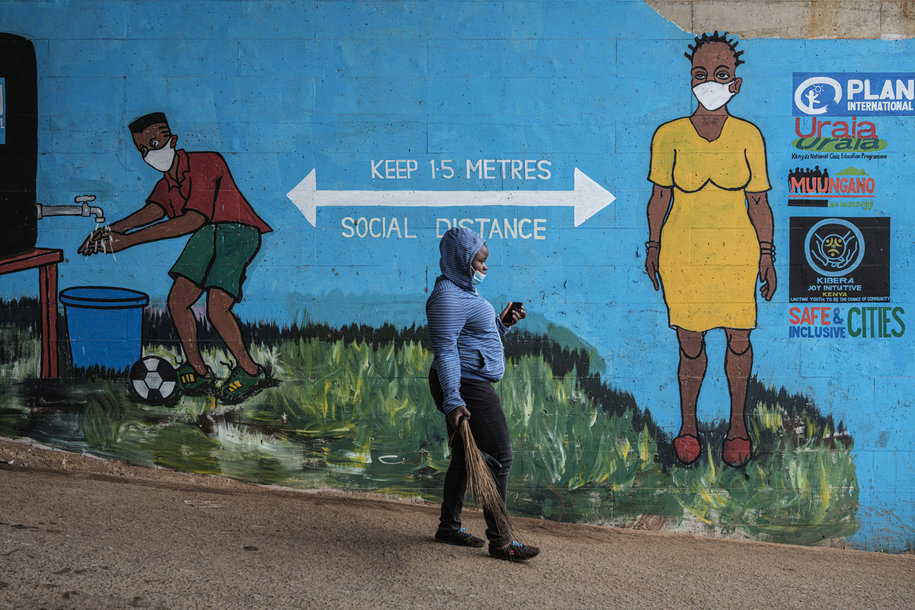 A woman walks in Kibera, Nairobi, Kenya, on July 15.