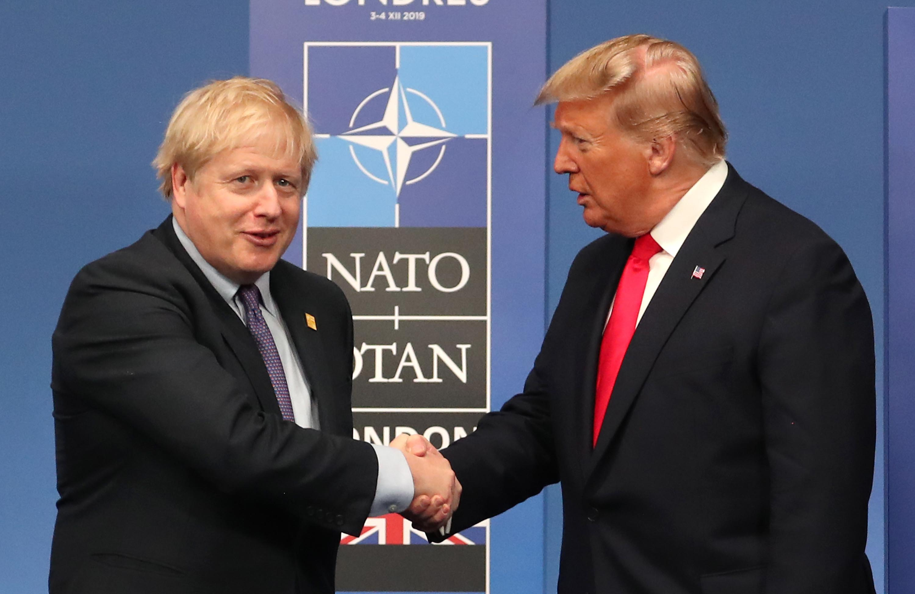 British Prime Minister Boris Johnson shakes hands with US President Donald Trump during the NATO heads of government summit on December 4, in Watford, England. Photo: Steve Parsons/WPA Pool/Getty Images