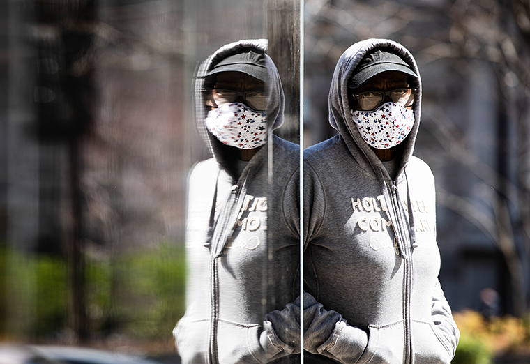 A person wearing a protective mask walks in Philadelphia, Thursday, April 2. (