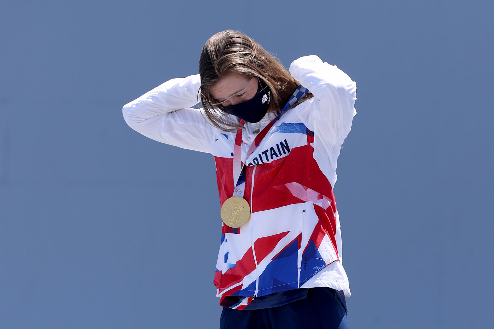 Worthington accepts her gold medal.
